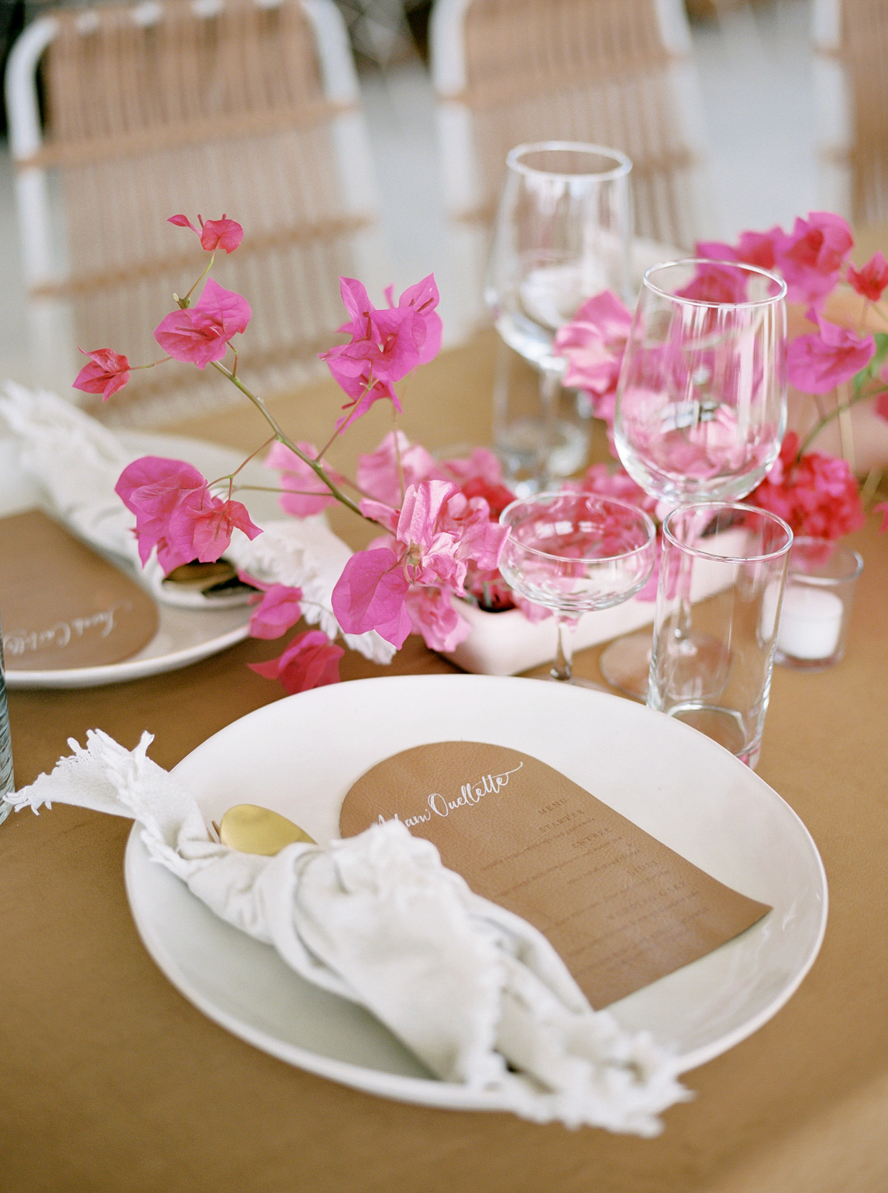 place setting with napkins and menu