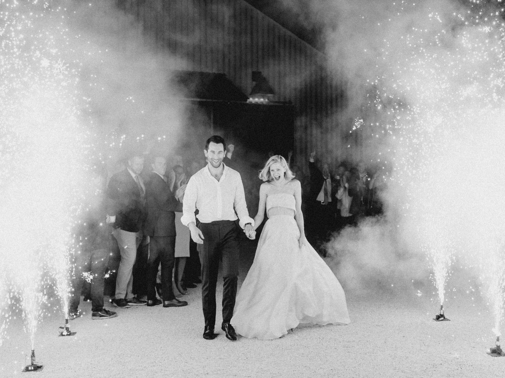 bride and groom exiting reception to sparklers