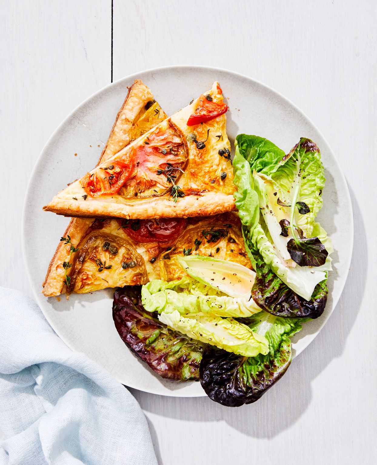 side salad with tomato and brie tart