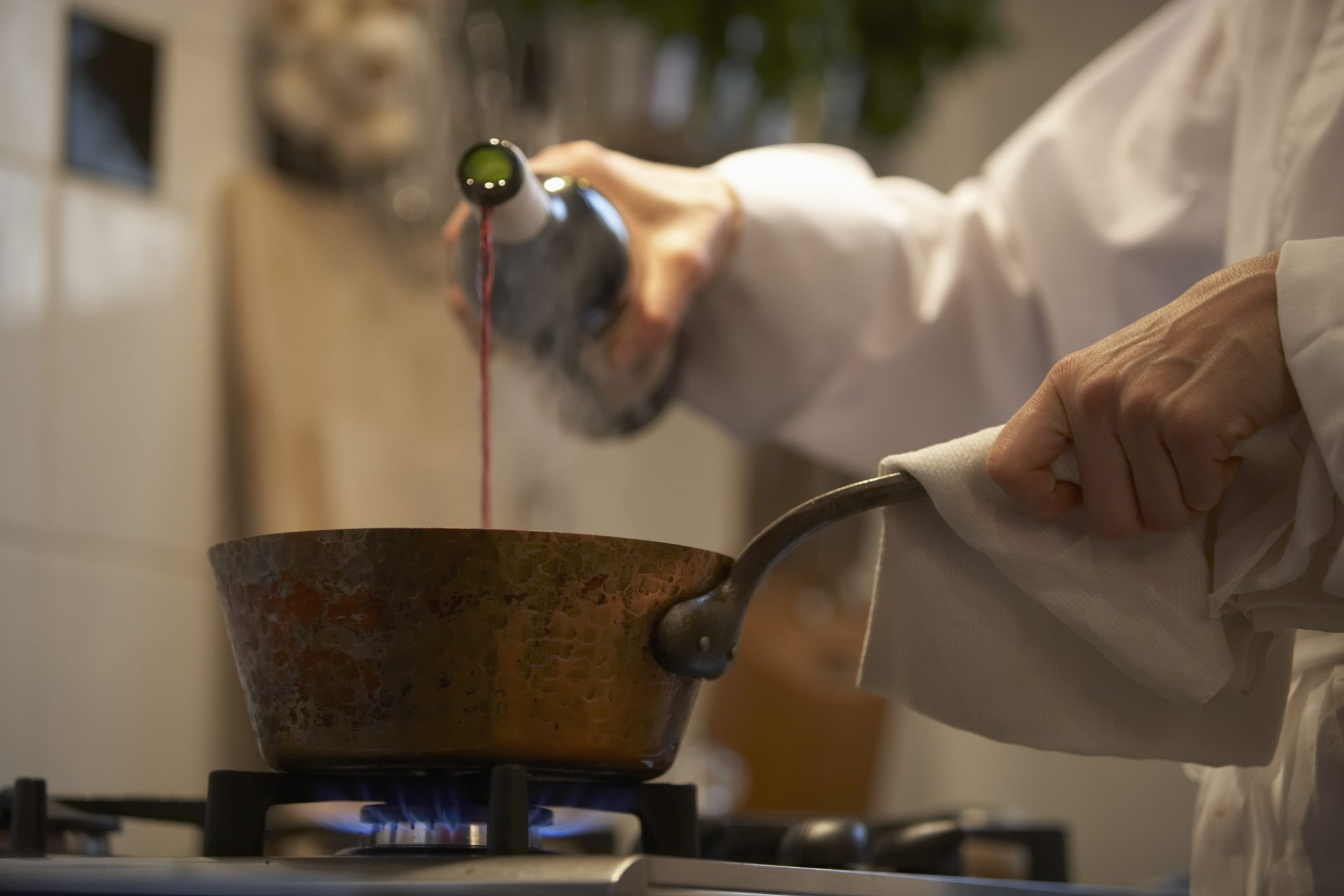 chef cooking with red wine