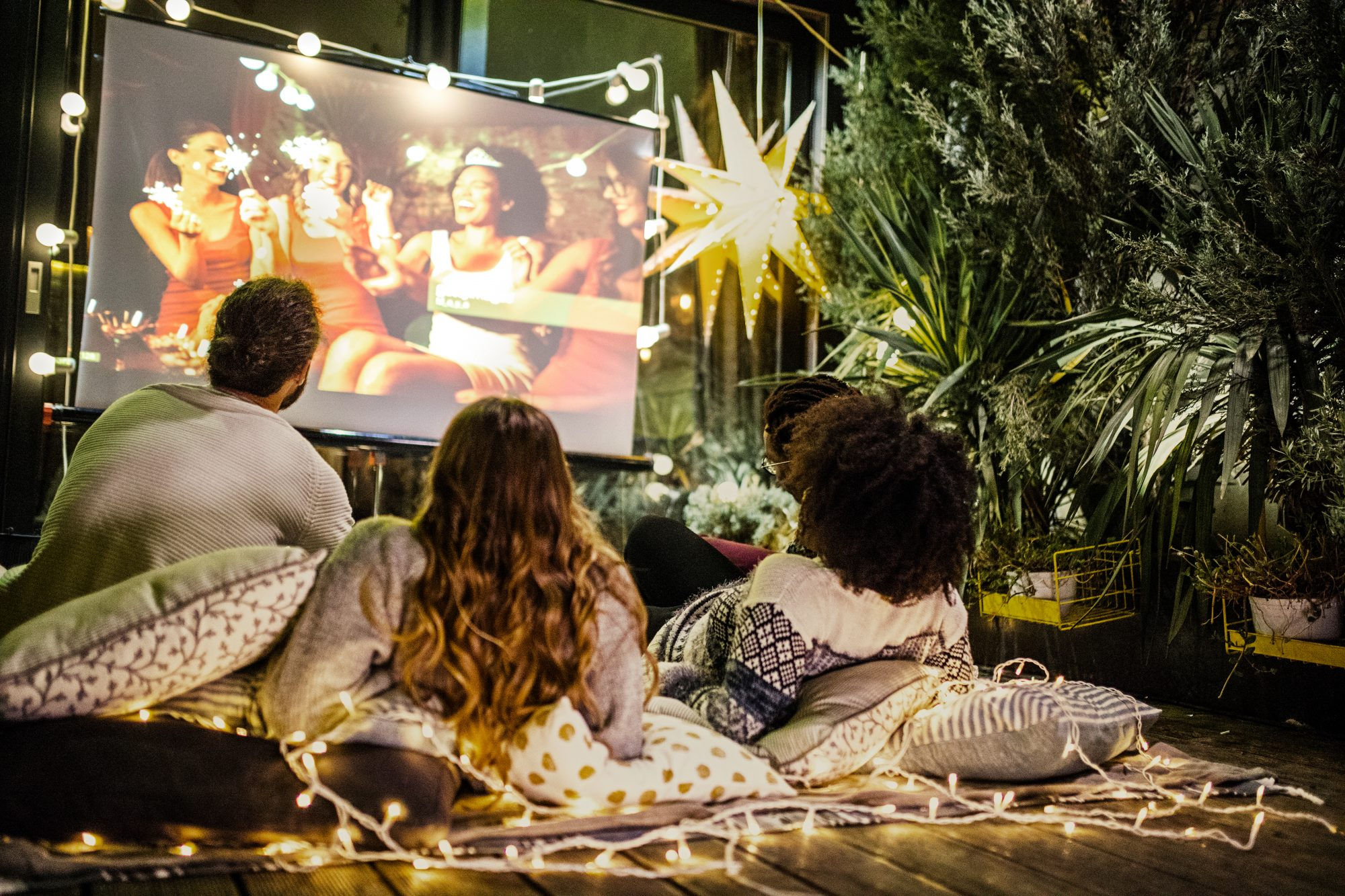 friends gathered in backyard for movie night