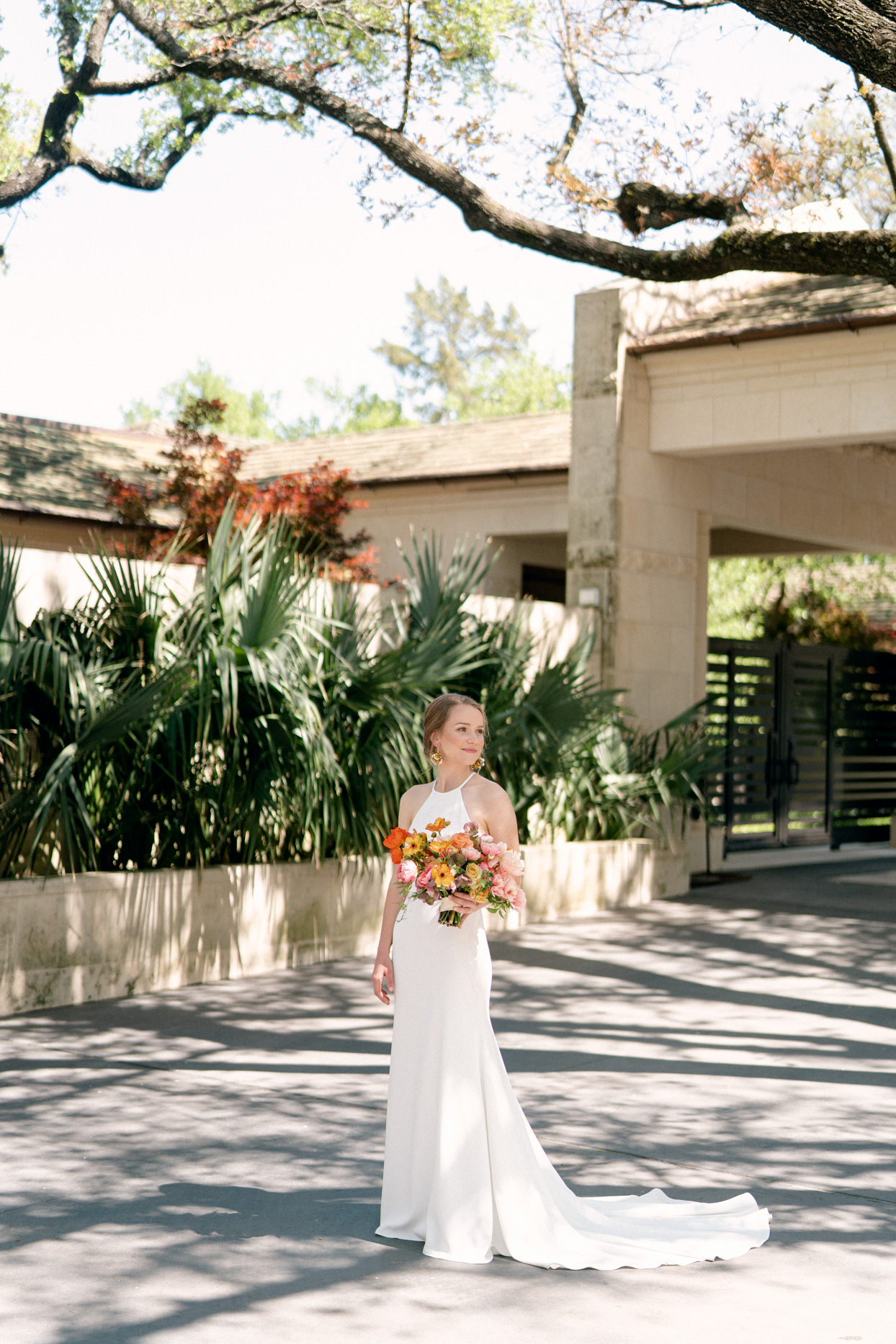 bride with bouquet near greenery