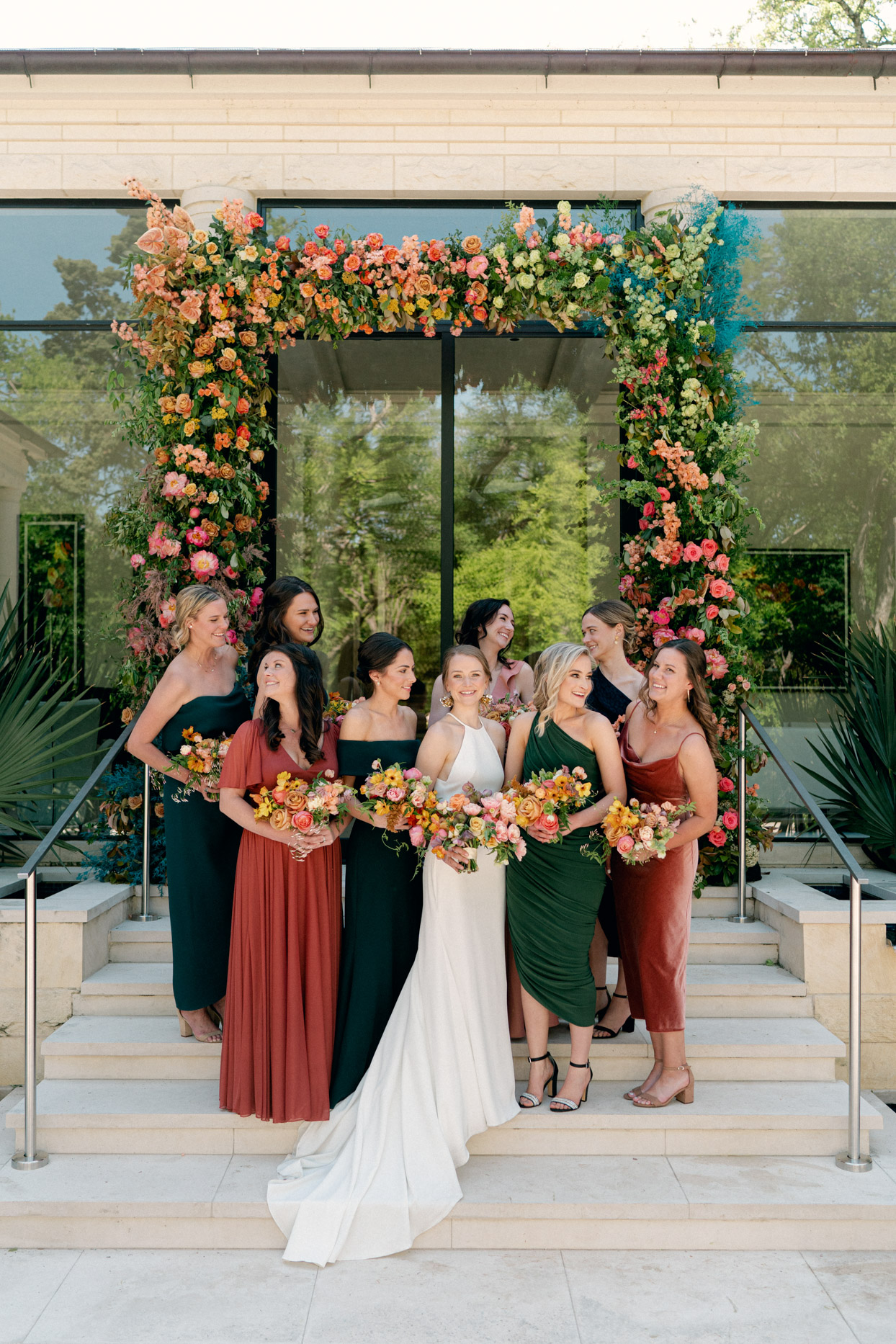 bride on stairs with bridesmaids