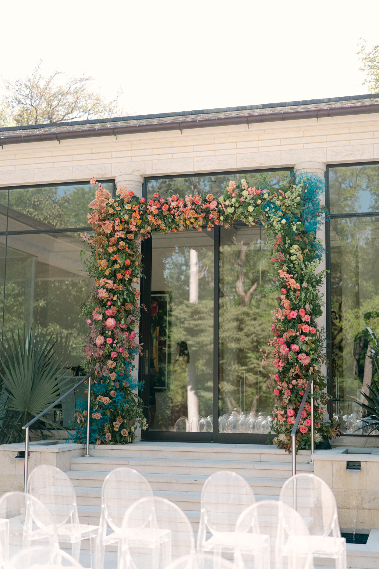 floral wedding arch with pink flowers