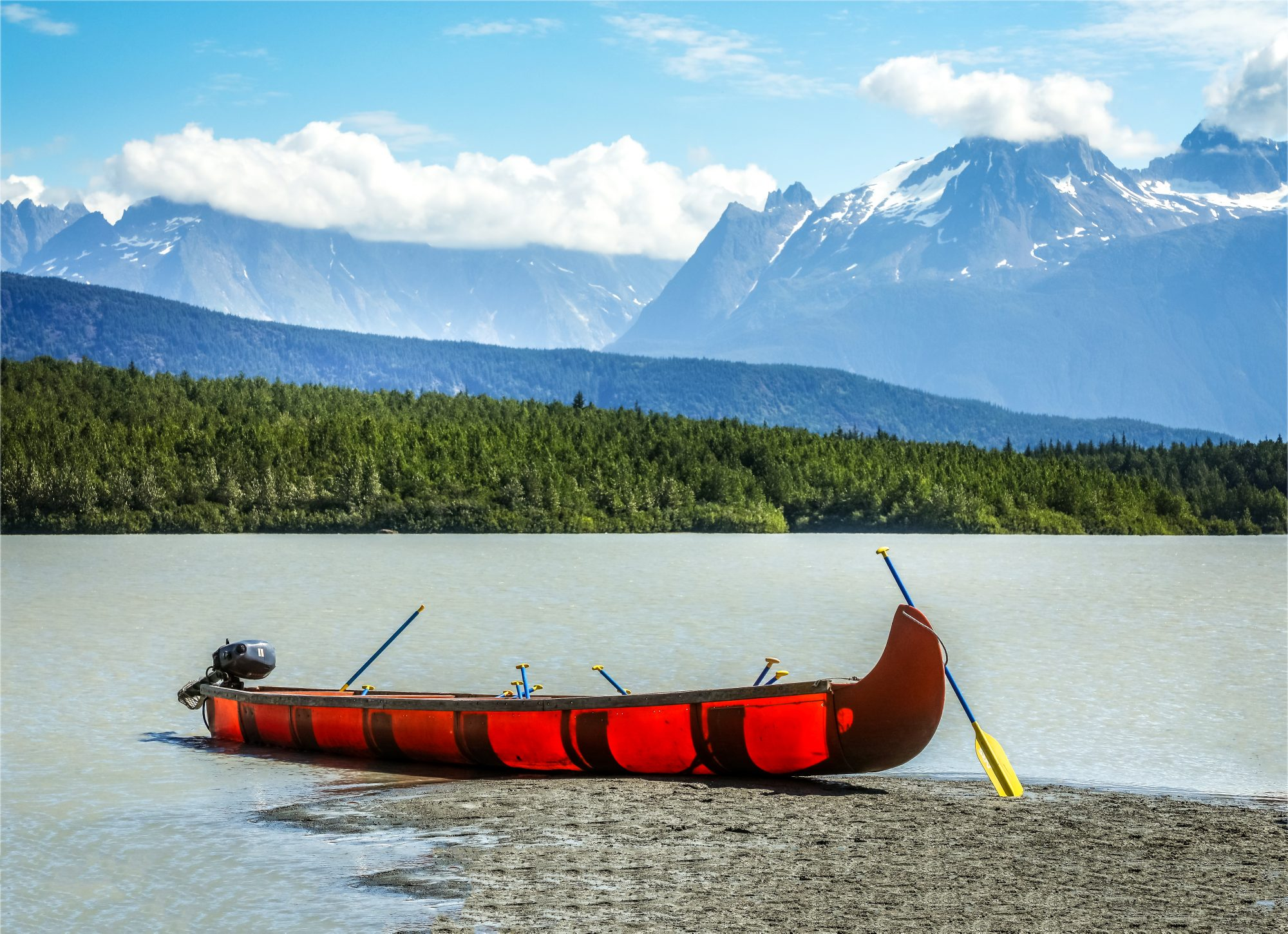 Scenic View Of Lake With A Canoe Against Mountains, Alaska