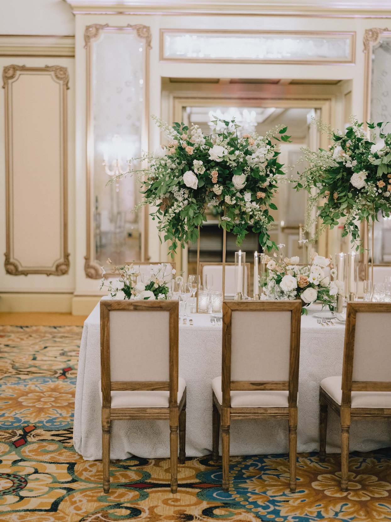 wedding reception tables with white tablecloths