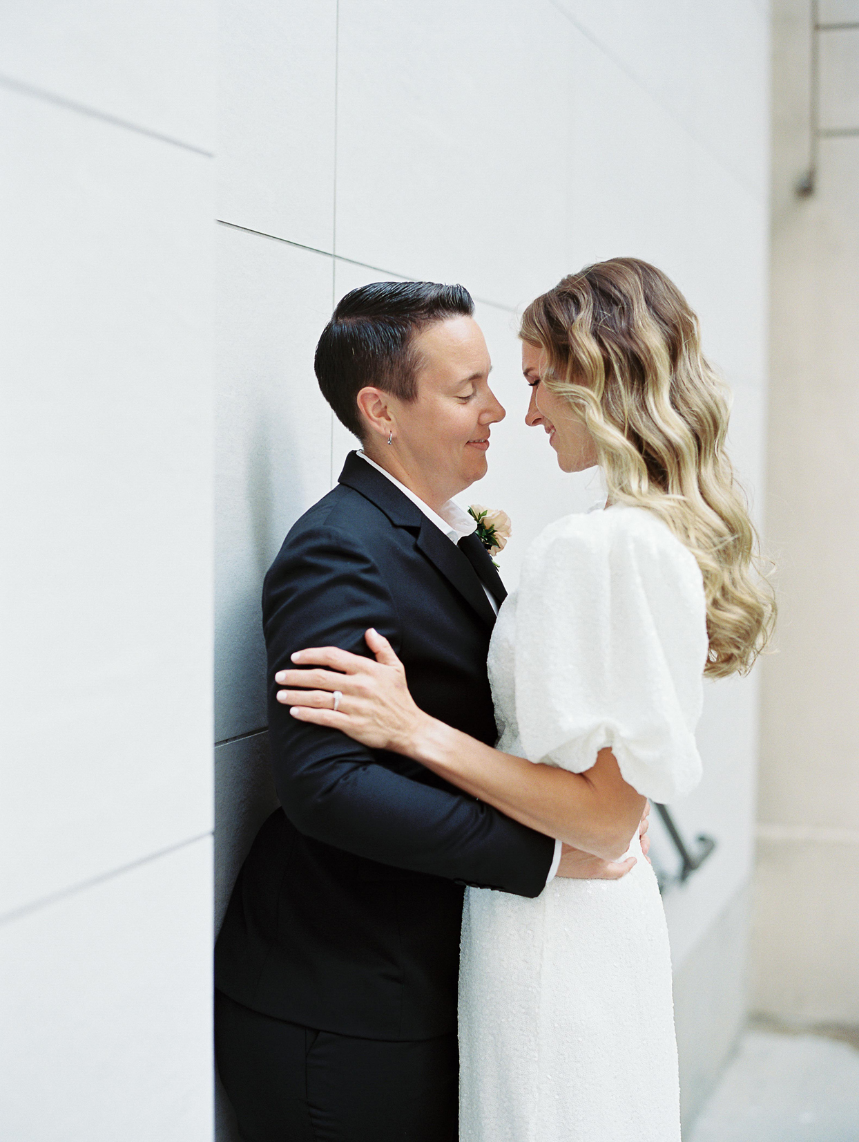 wedding couple embracing and smiling