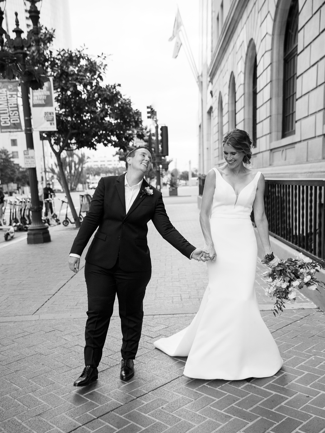 wedding couple holding hands and smiling