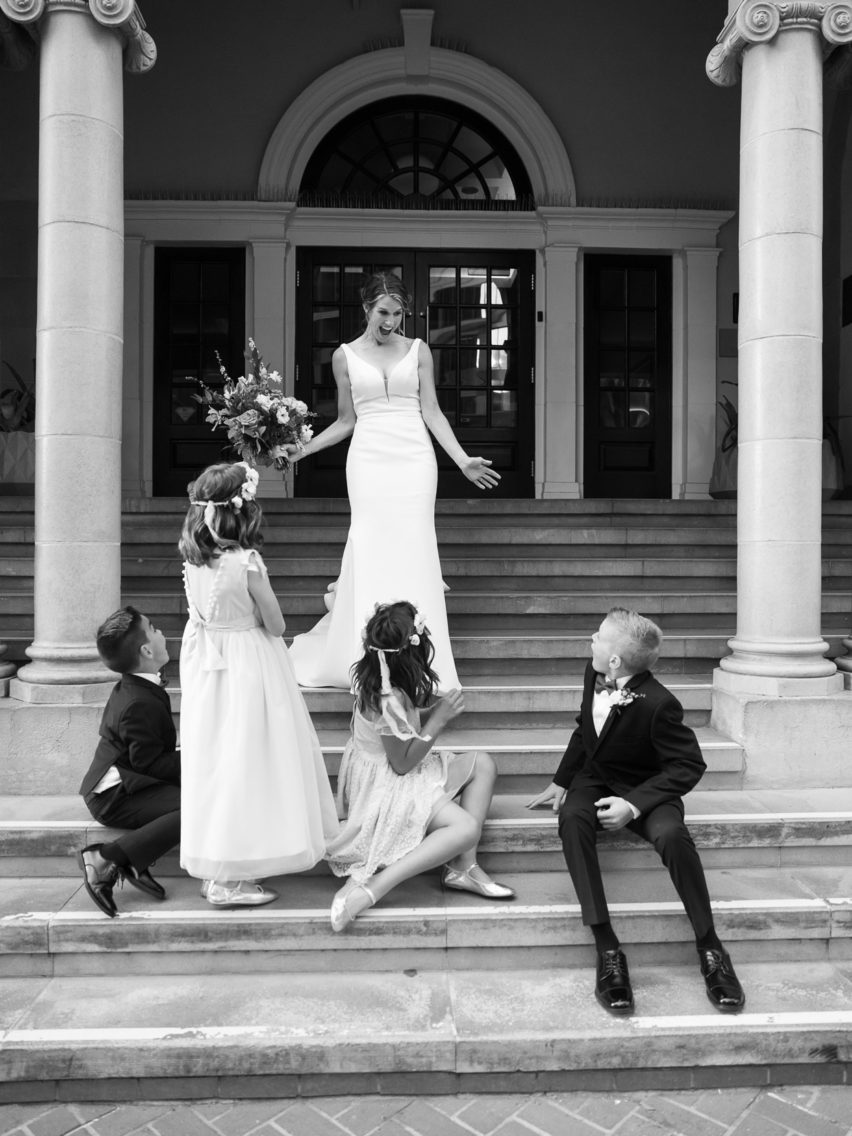 bride sharing first look with children on stairs