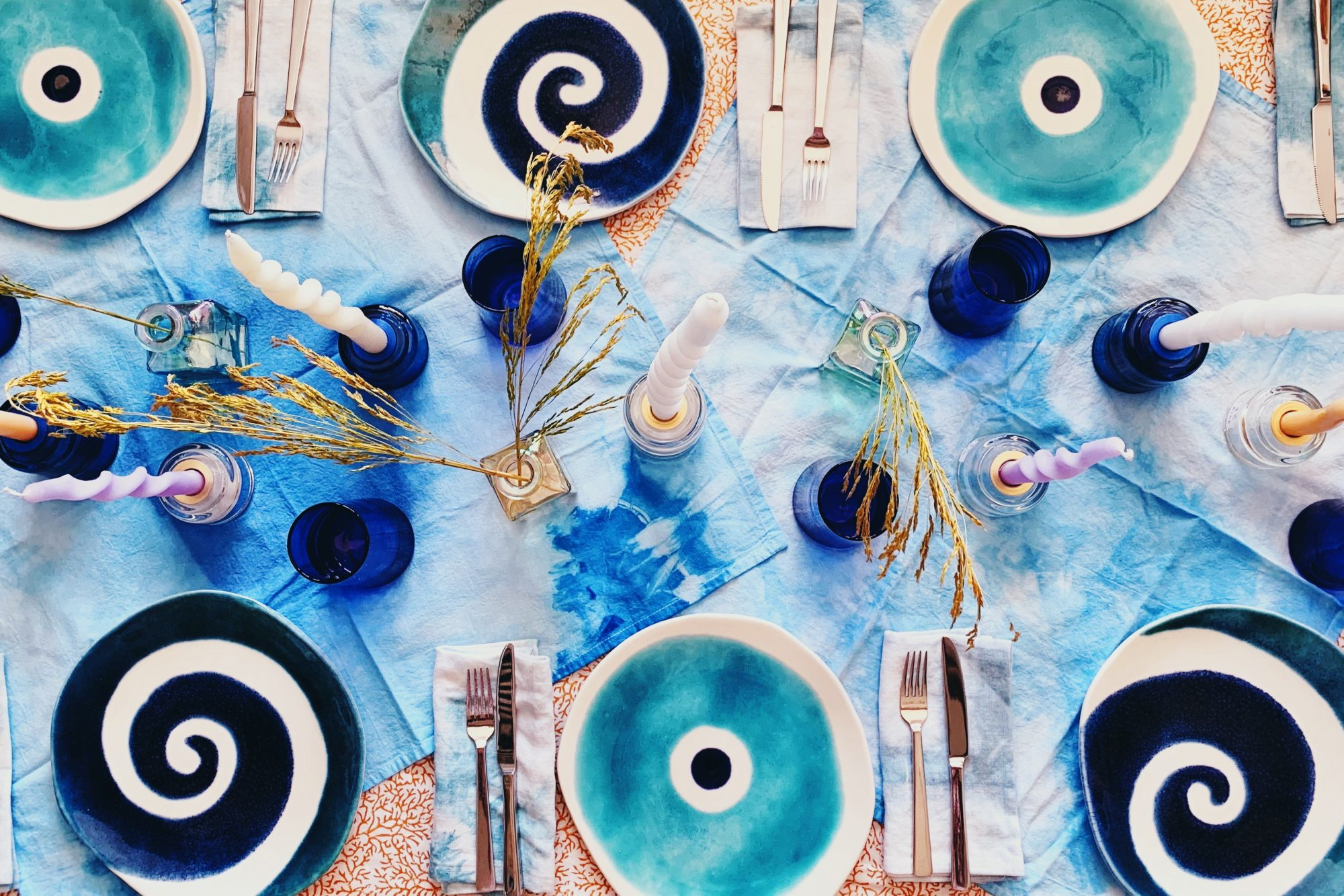 blue tablescape with colorful plates