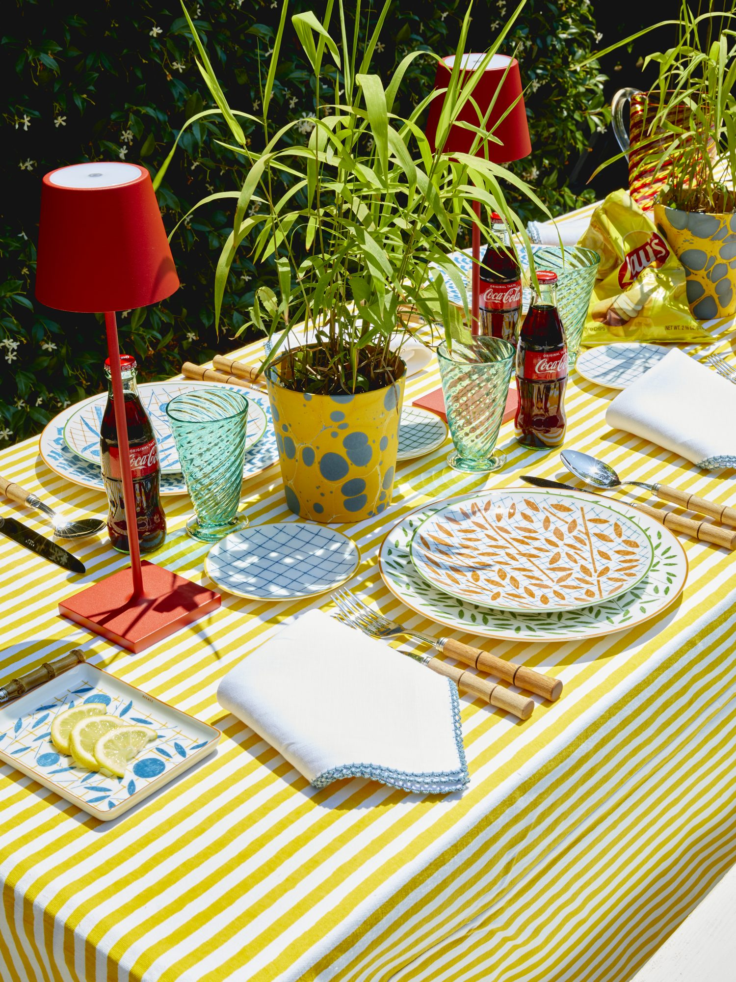 outdoor place setting with yellow tablecloth