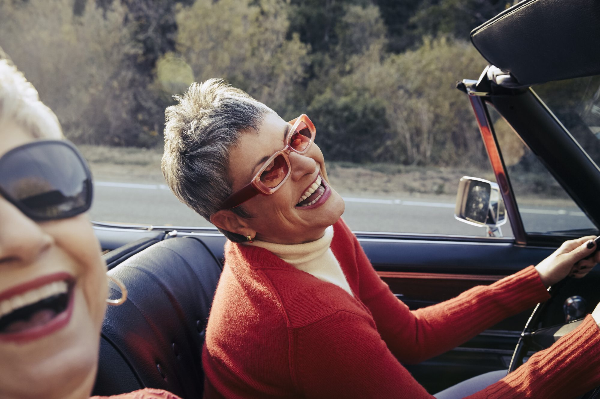 mature woman driving in convertible