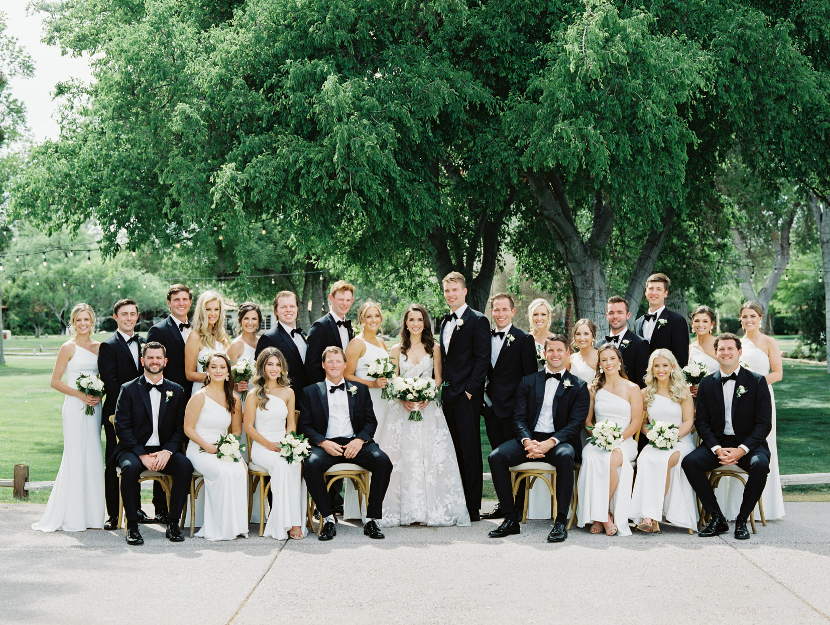bride and groom with wedding party all wearing black and white