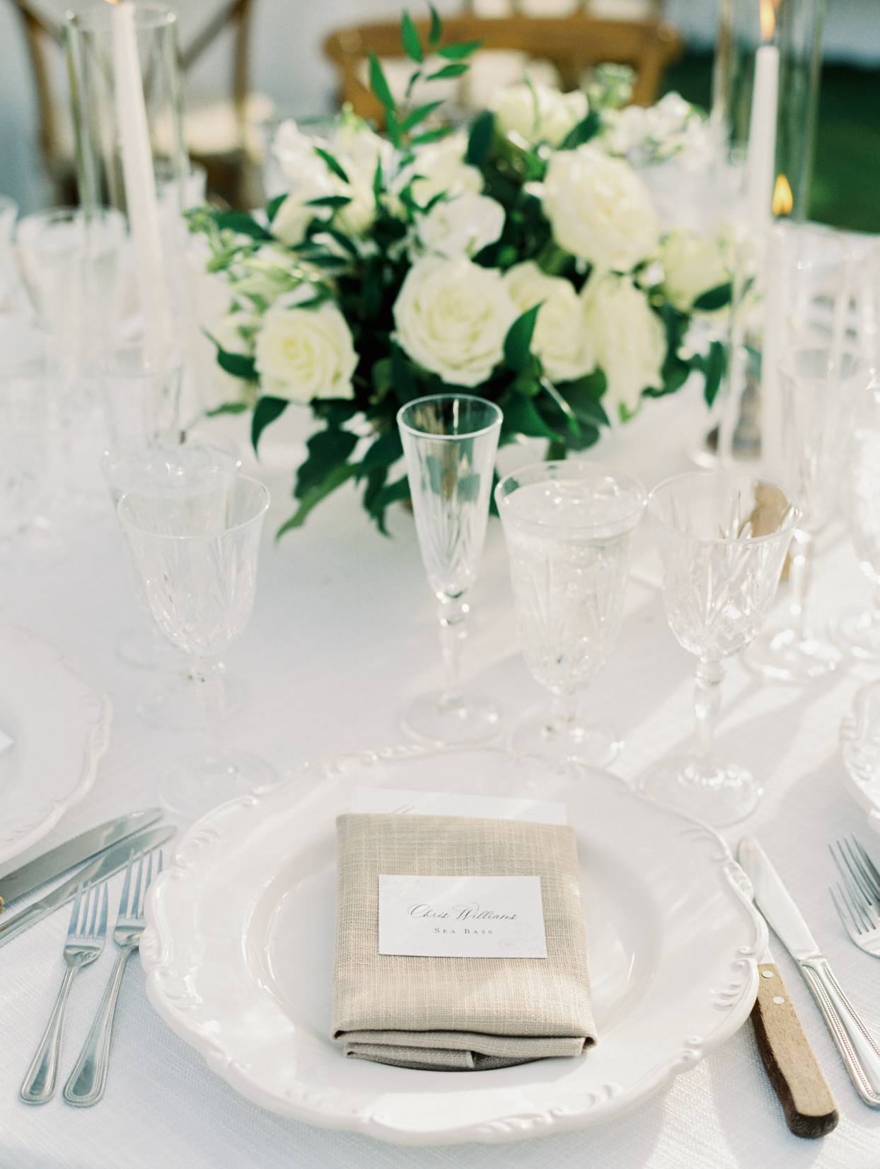 crystal and white wedding reception place settings