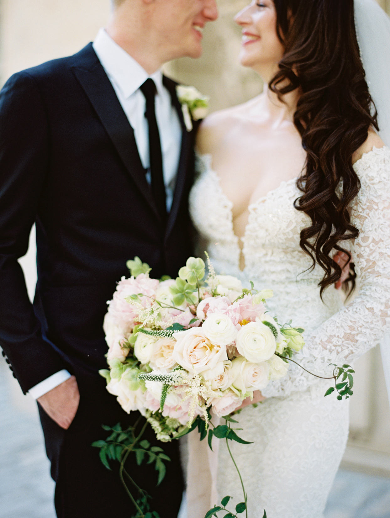bridal bouquet comprised of dahlias garden roses pink astilbe and ranunculus