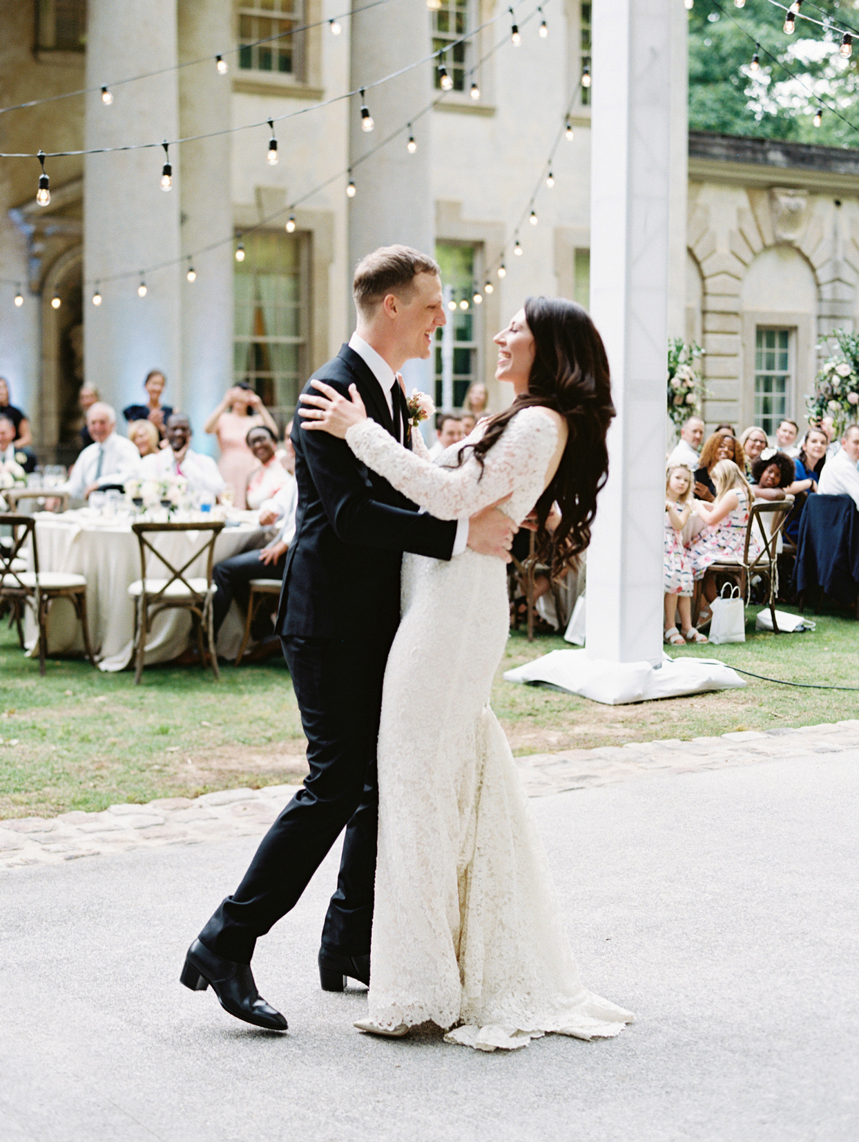 bride and groom sharing first dance