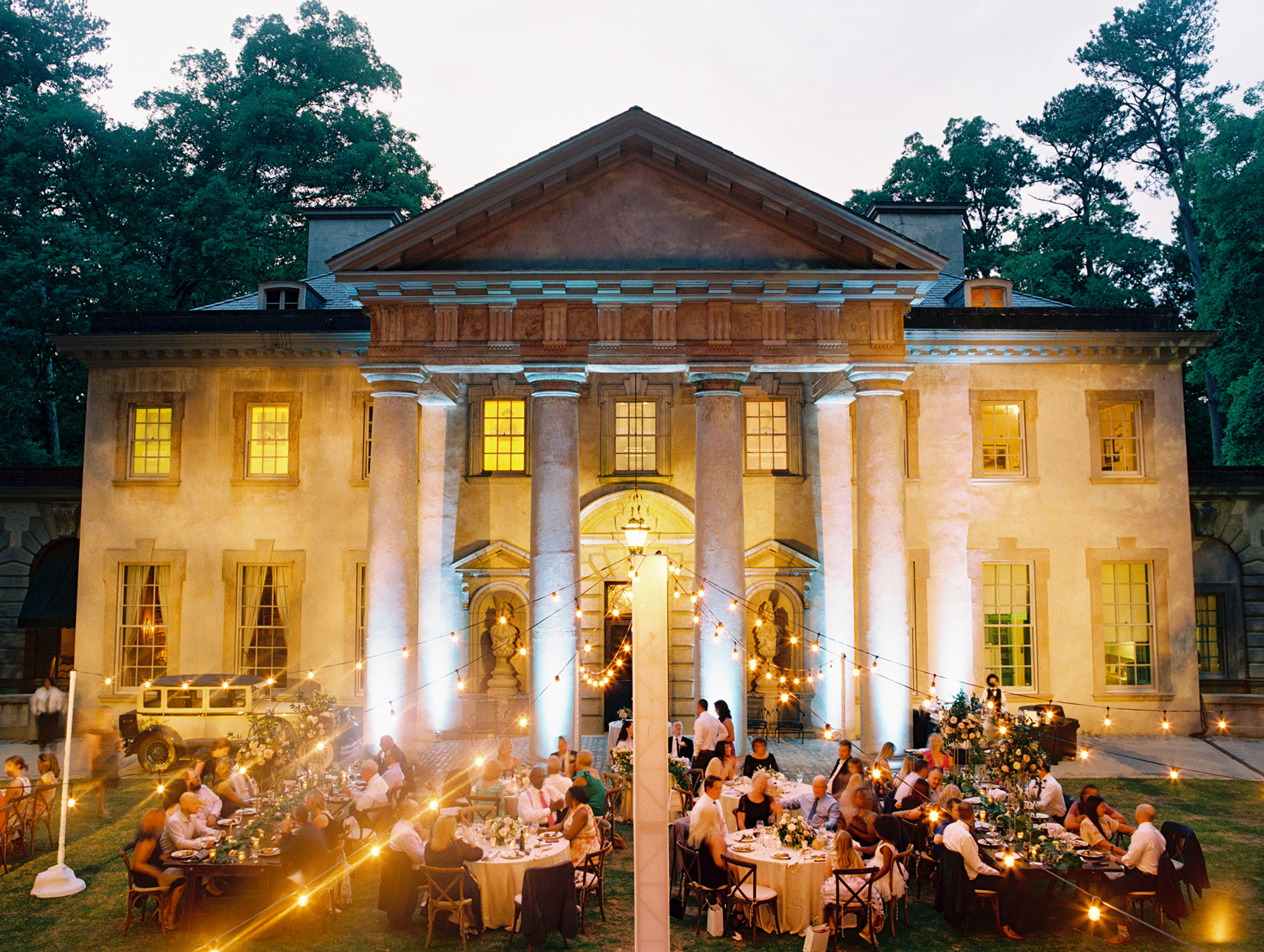 outdoor wedding reception with suspended cafe string lighting