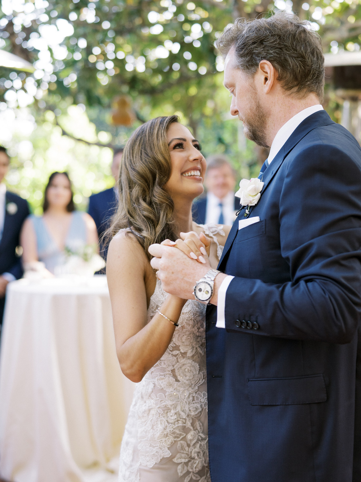 bride smiles at groom during first dance