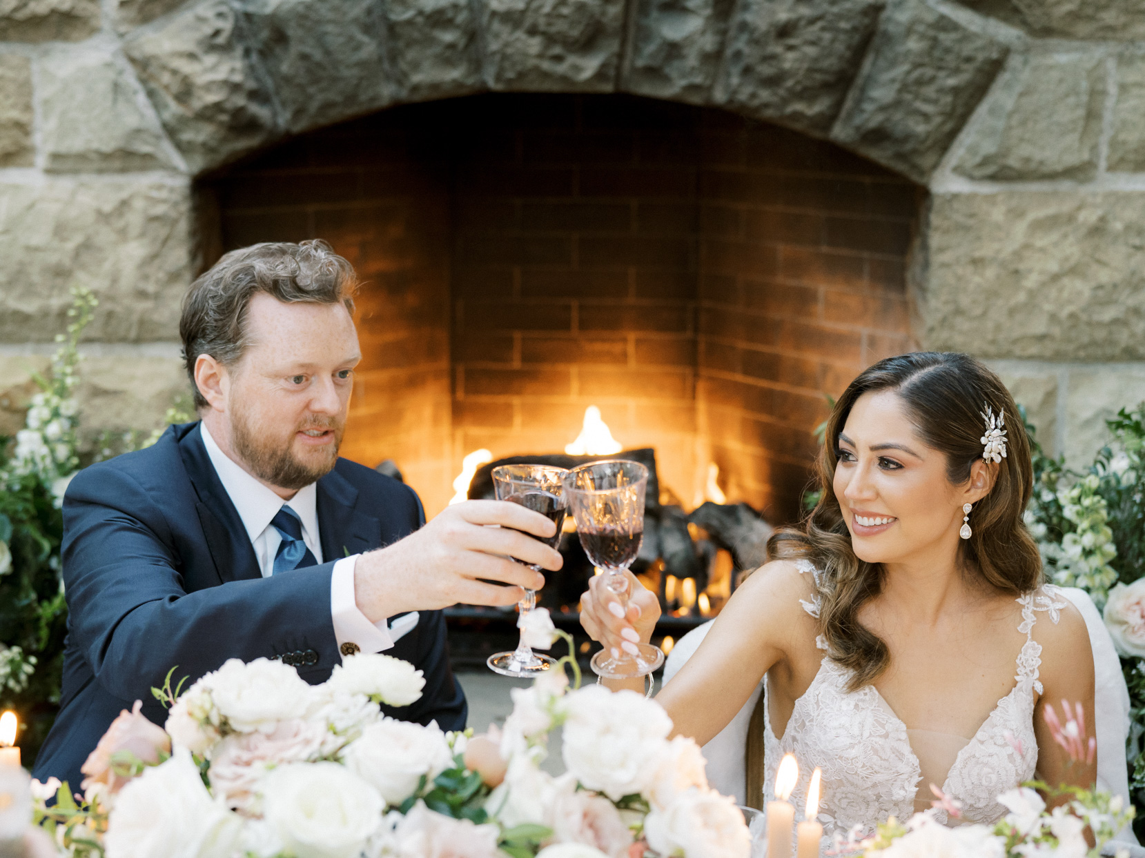 bride and groom cheers with red wine