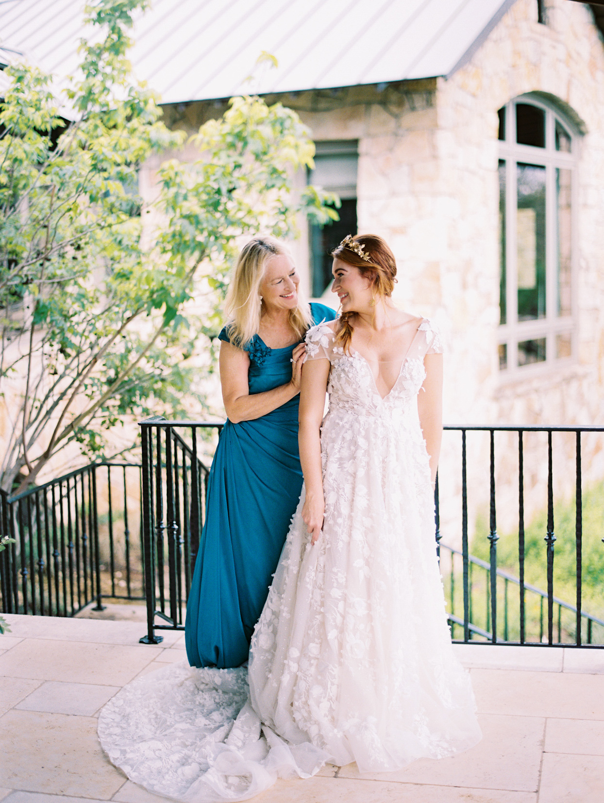 bride standing with mom wearing blue dress