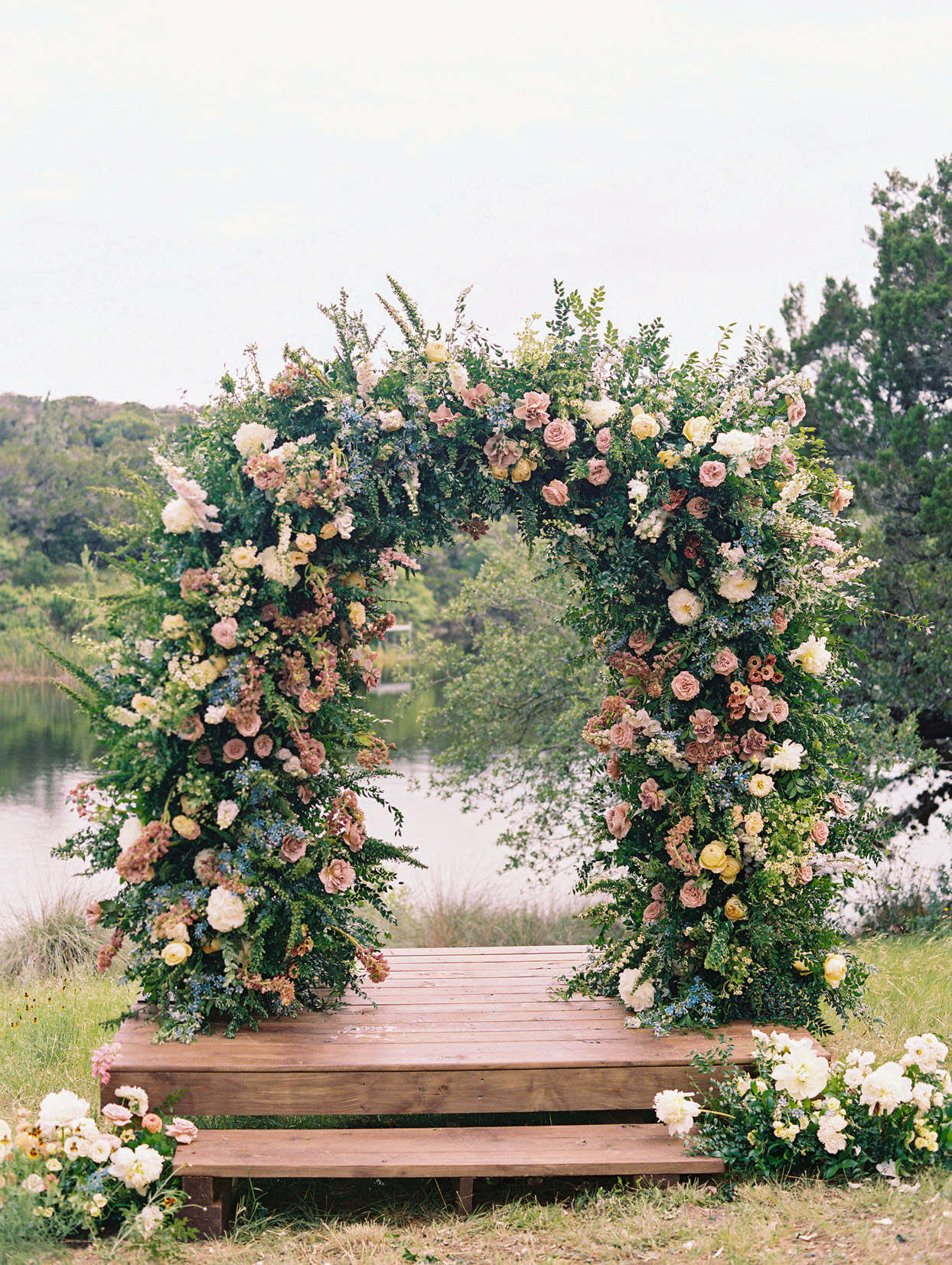 large colorful floral wedding arch