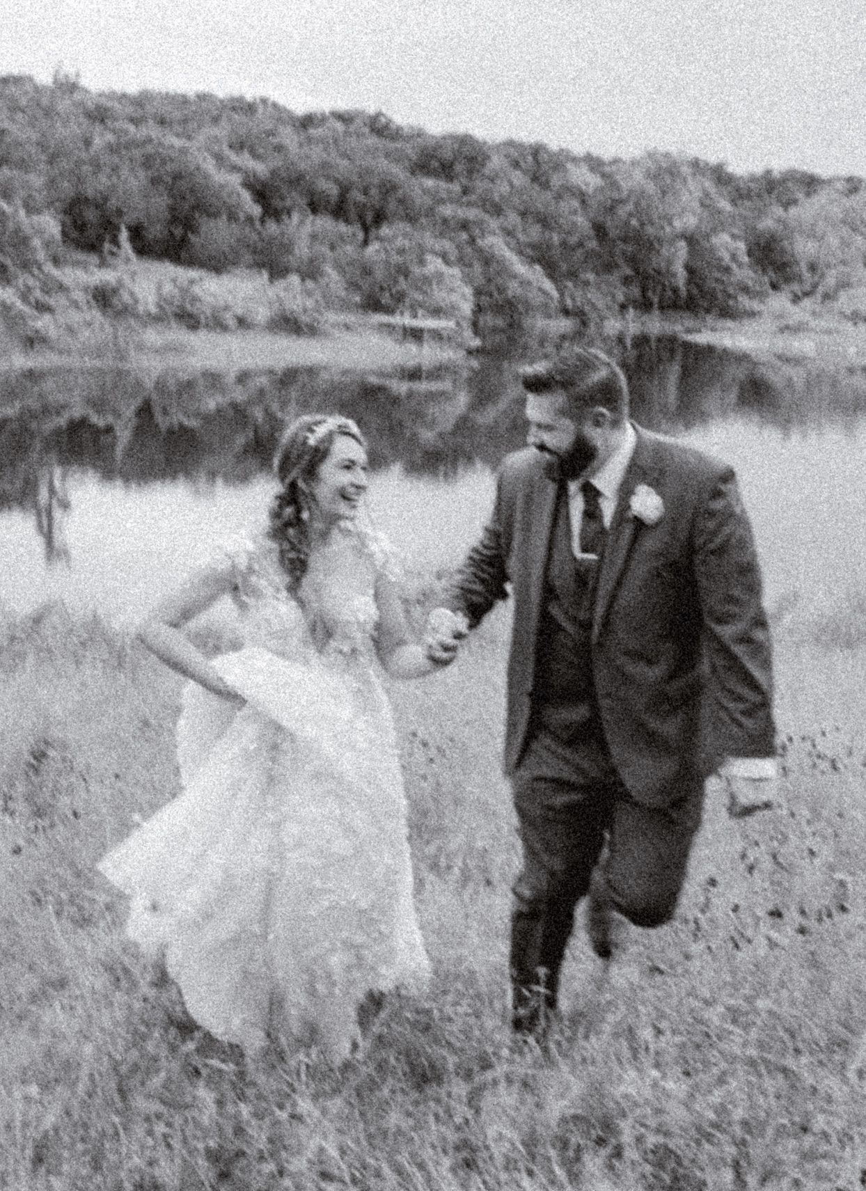 bride and groom smiling in black and white portrait shot