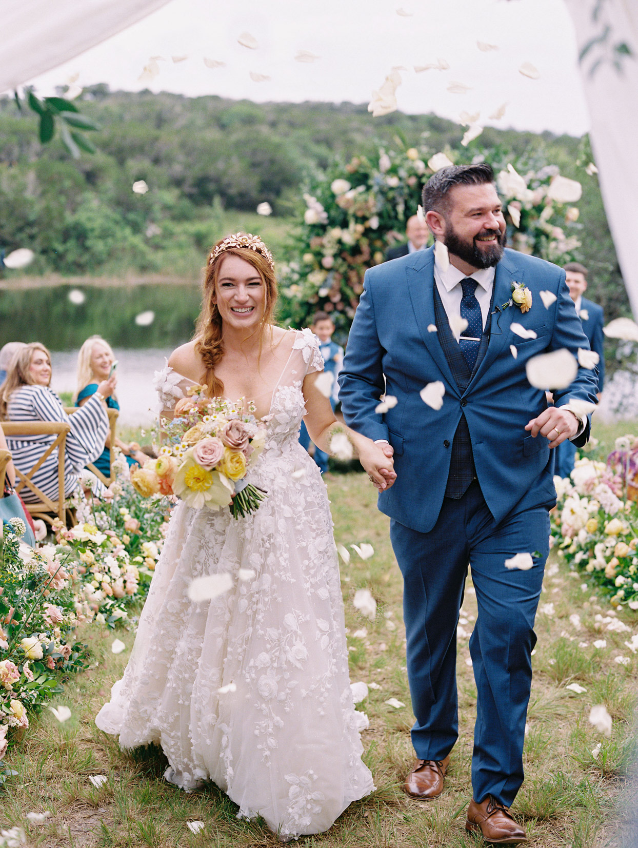 bride and groom showered with floral petals
