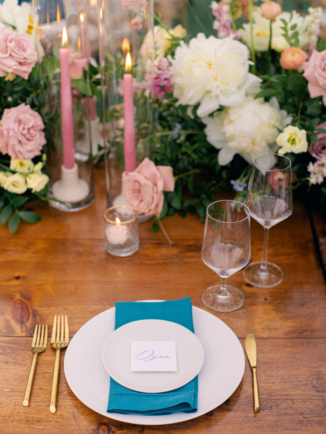 white and gold place settings