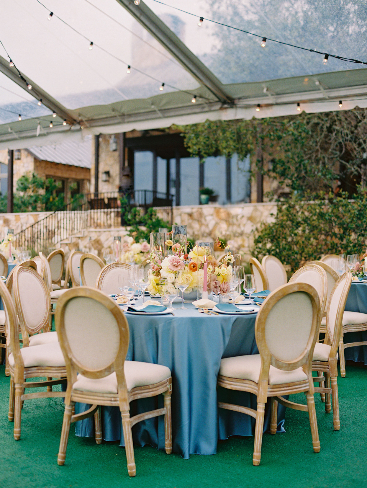 round reception tables with blue linen tablecloths