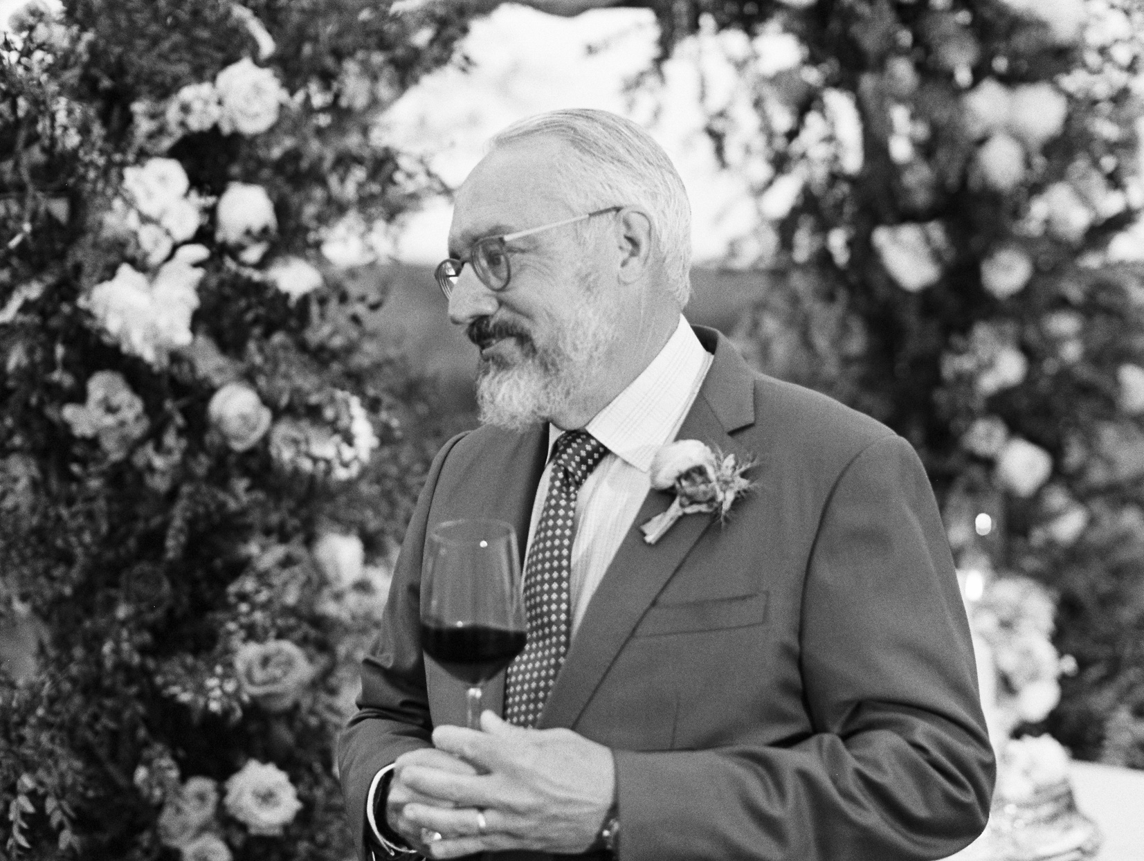 wedding guest holding wine glass during toast