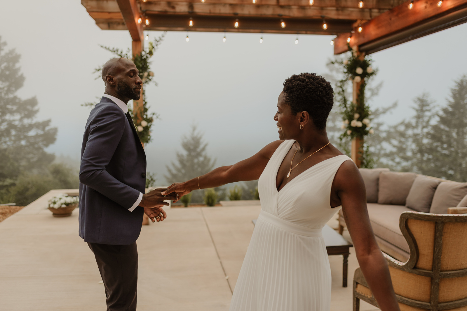 couple dancing at outdoor foggy wedding