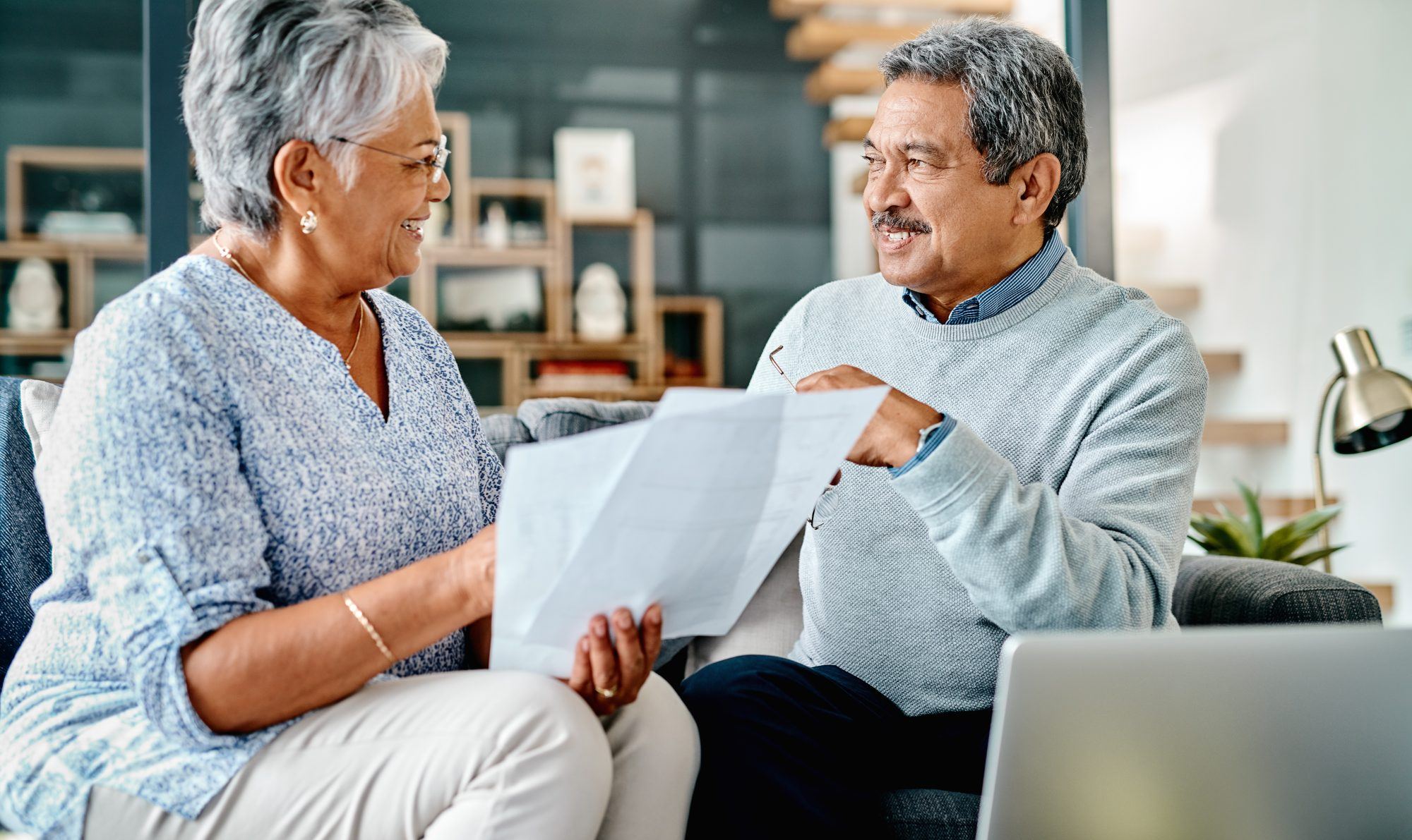 senior couple looking at tax documents