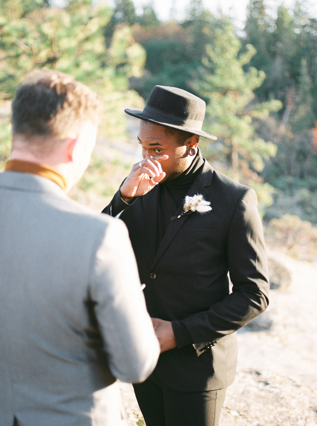 grooms reading vows during ceremony