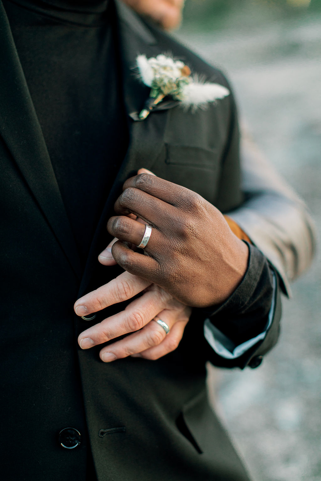 close up of grooms' wedding bands