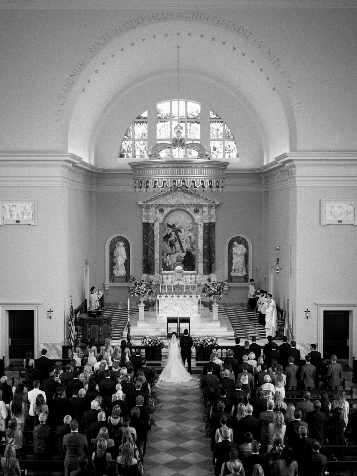 bride and groom surrounded by guests at church wedding ceremony