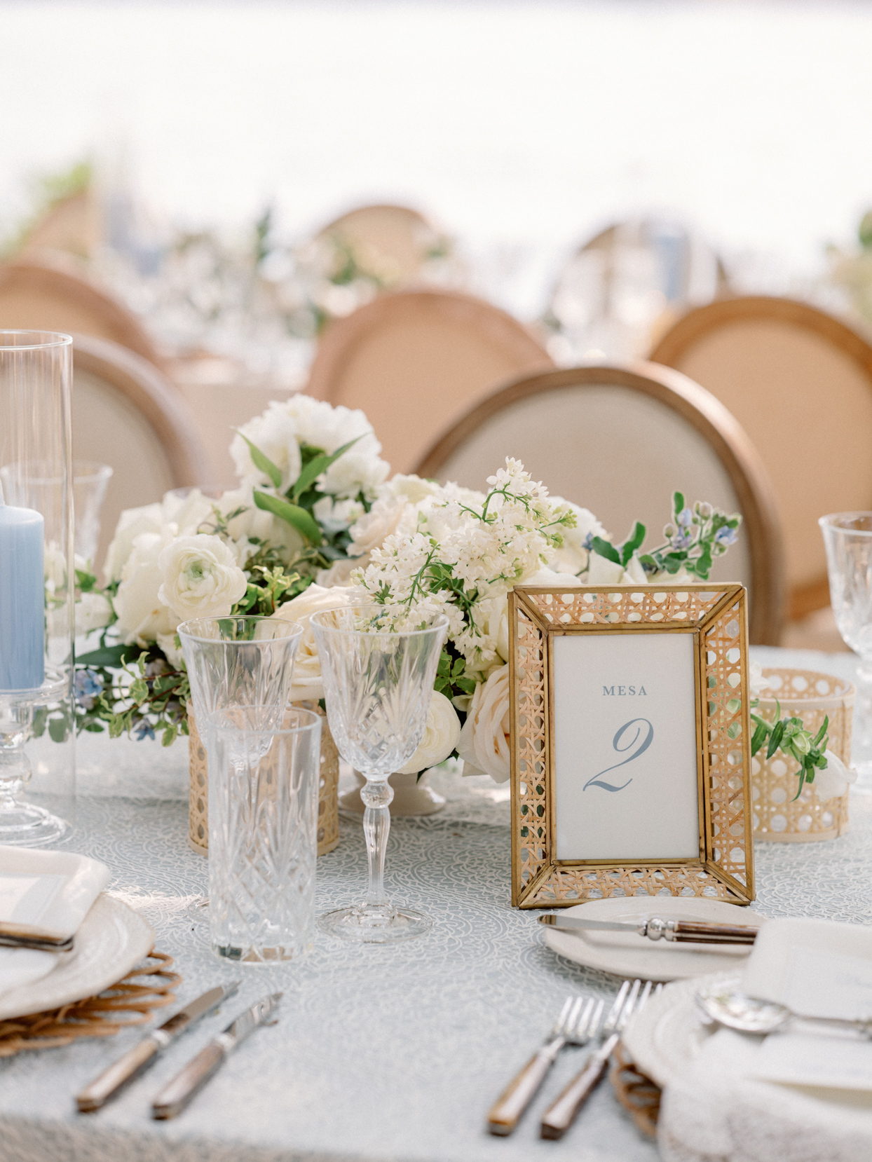 blue and white and gold reception place settings and decor