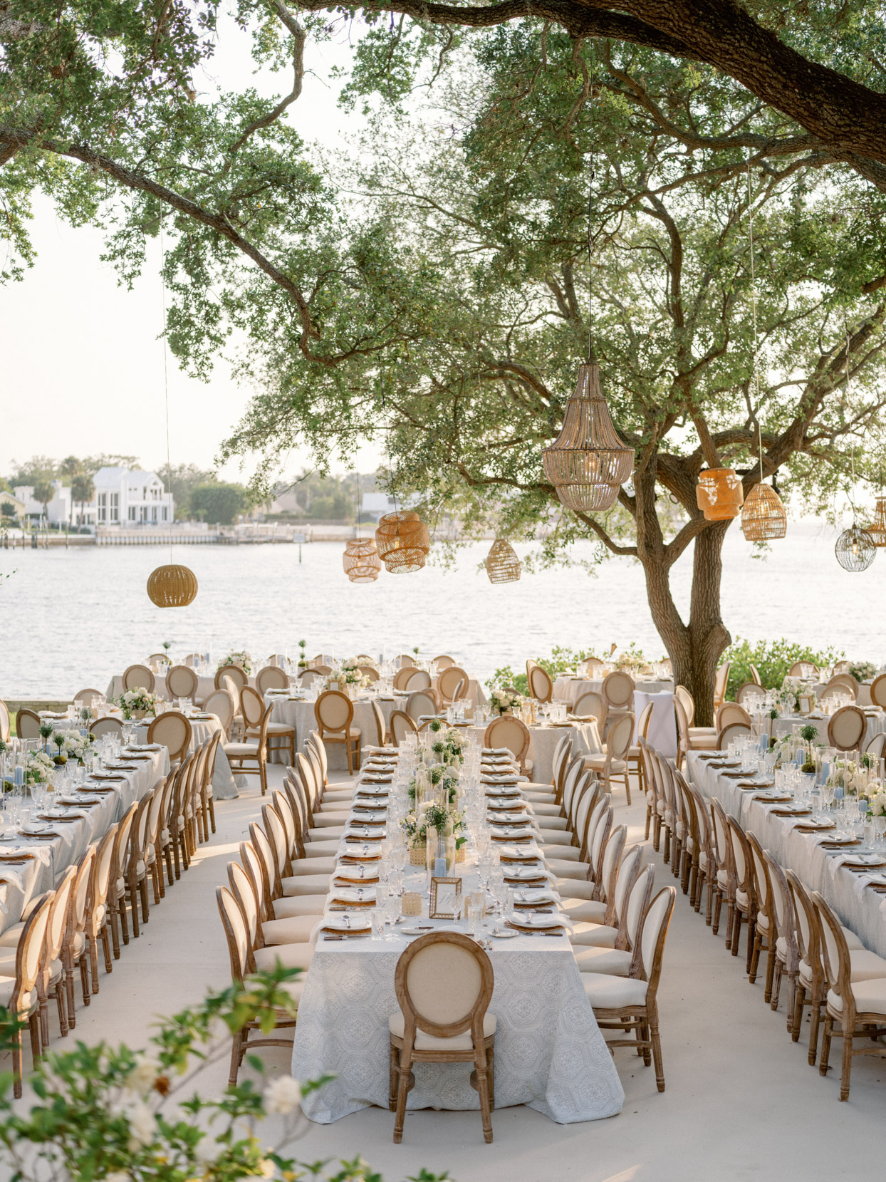 blue and white linen draped tables under wicker lanterns outside
