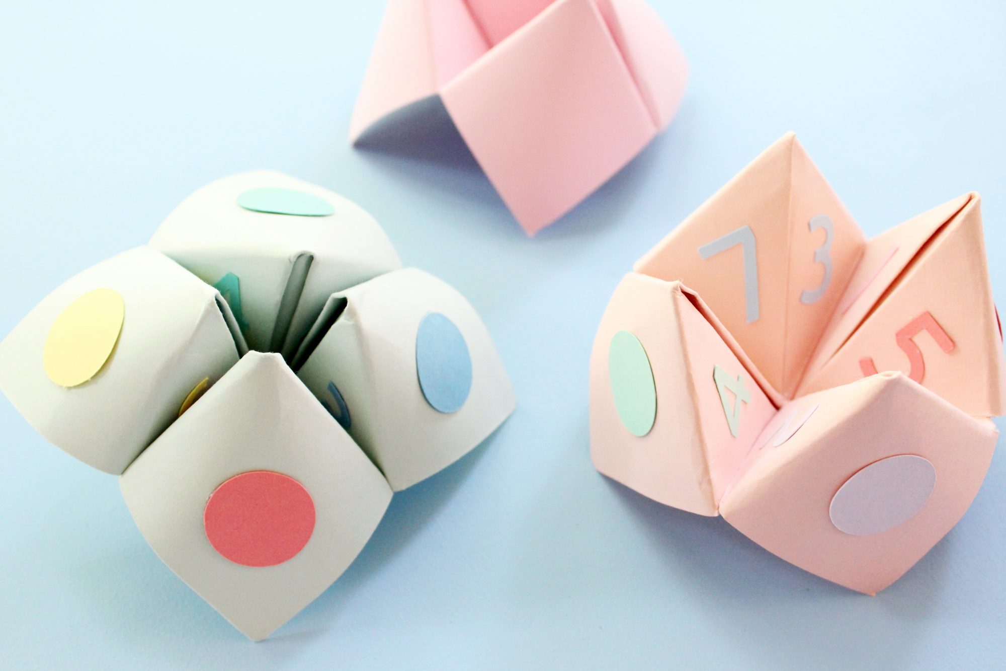 paper fortune tellers on blue surface