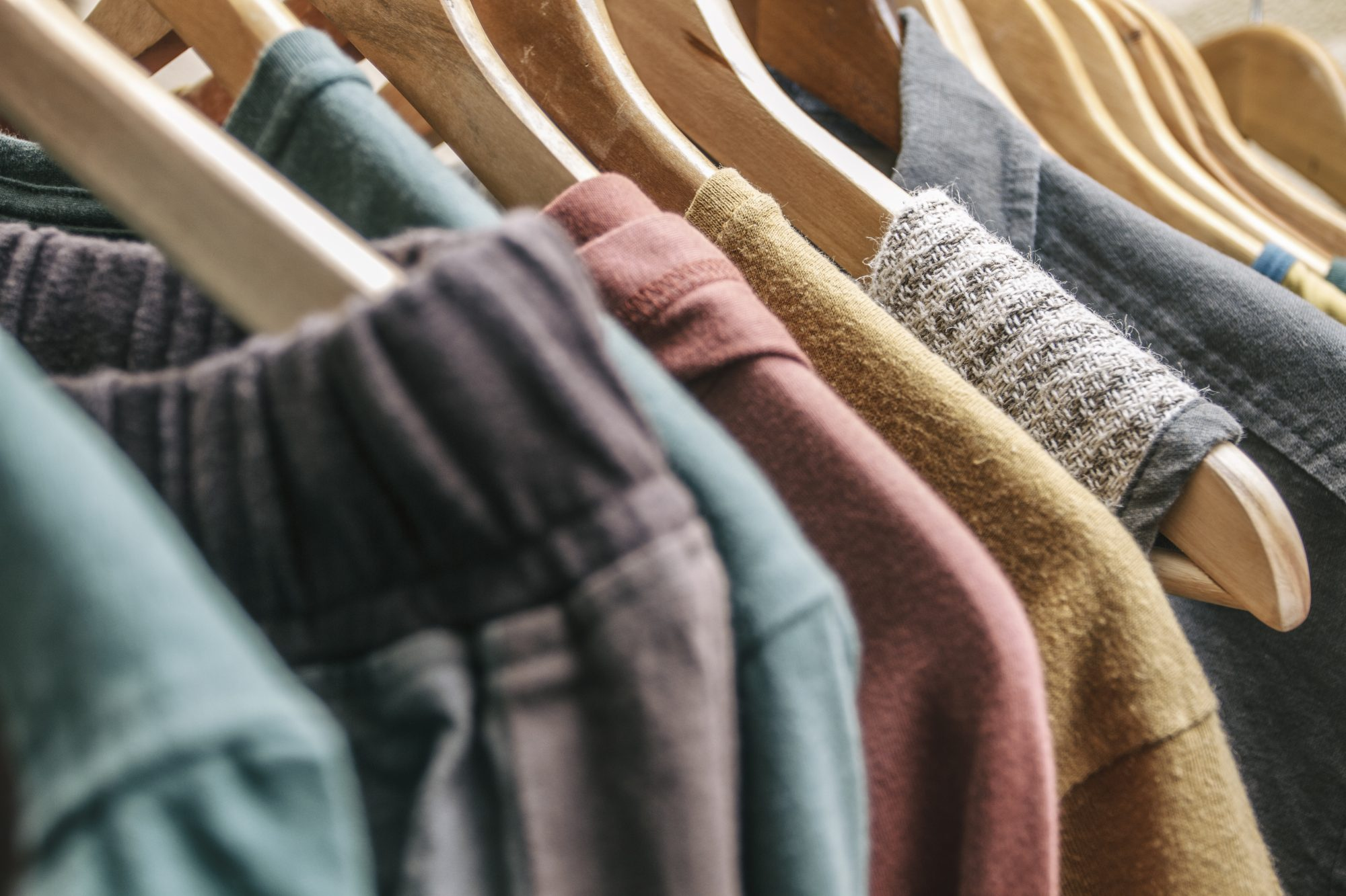 clothes hanging on wood hangers