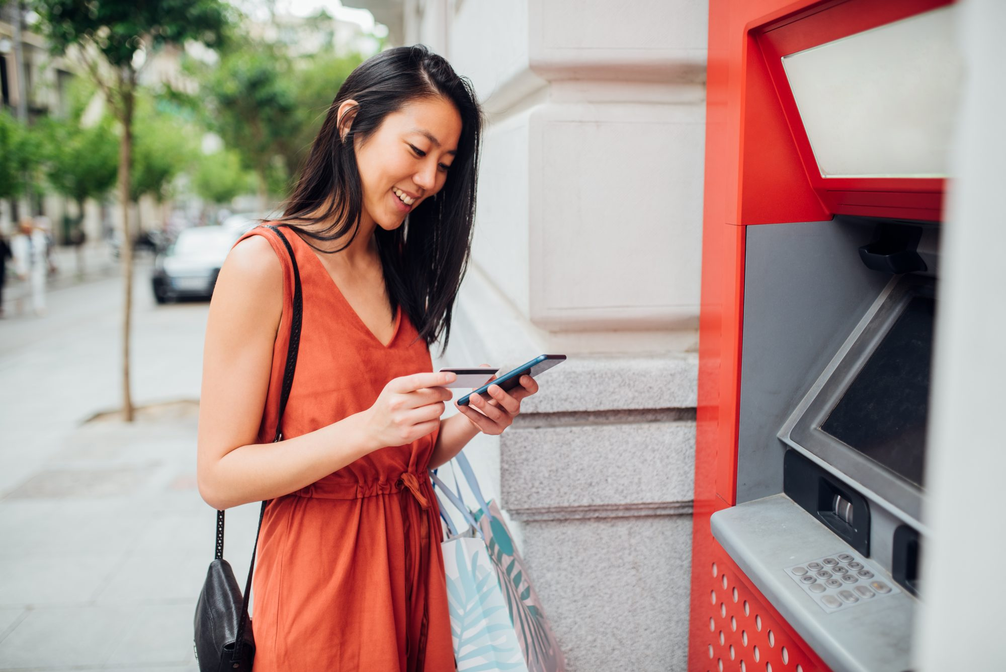 woman banking using atm