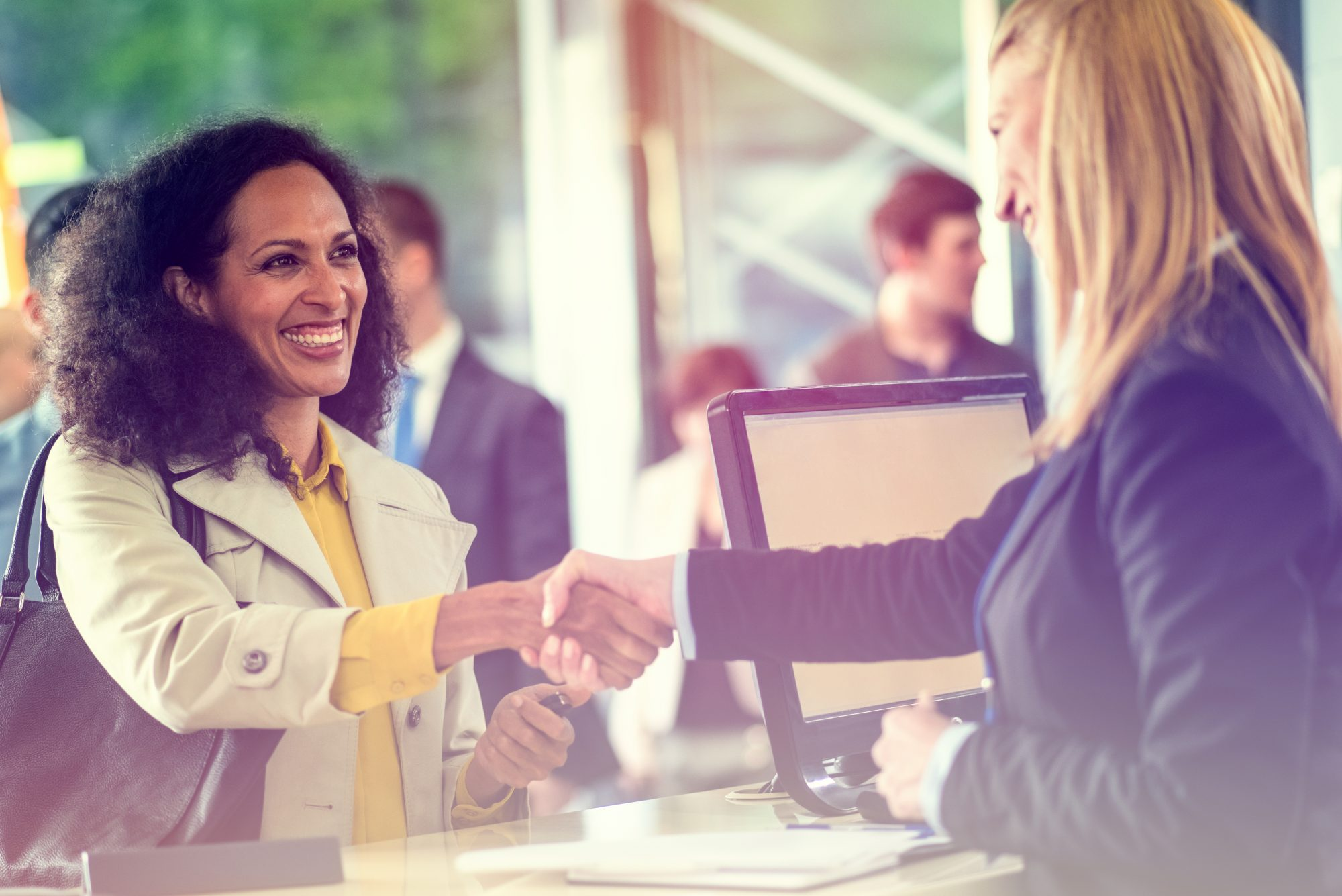 woman shaking hands with bank teller