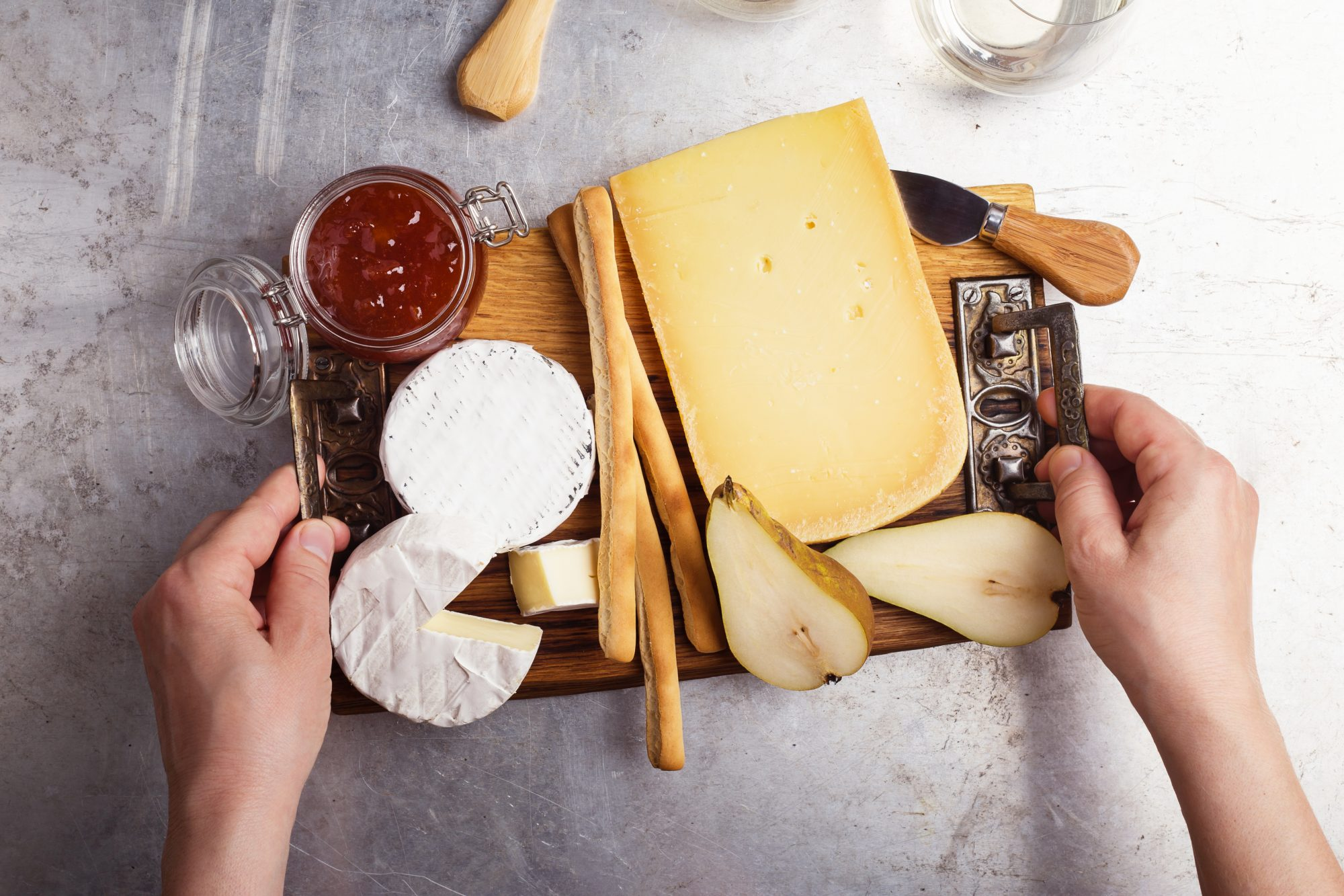 woman holding cheese platter