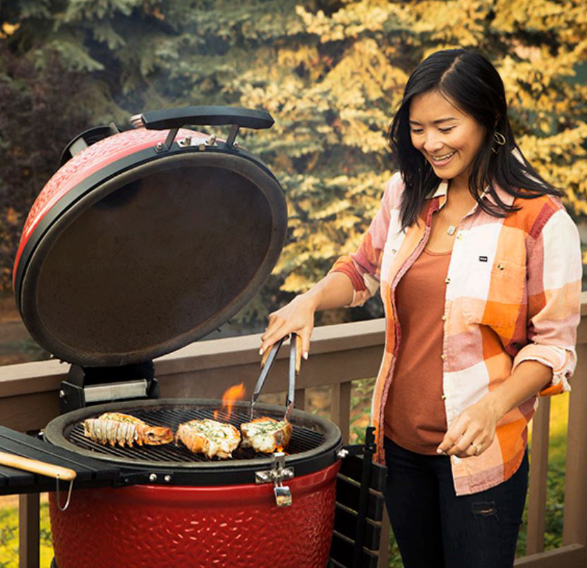 chef lina ly grilling on deck