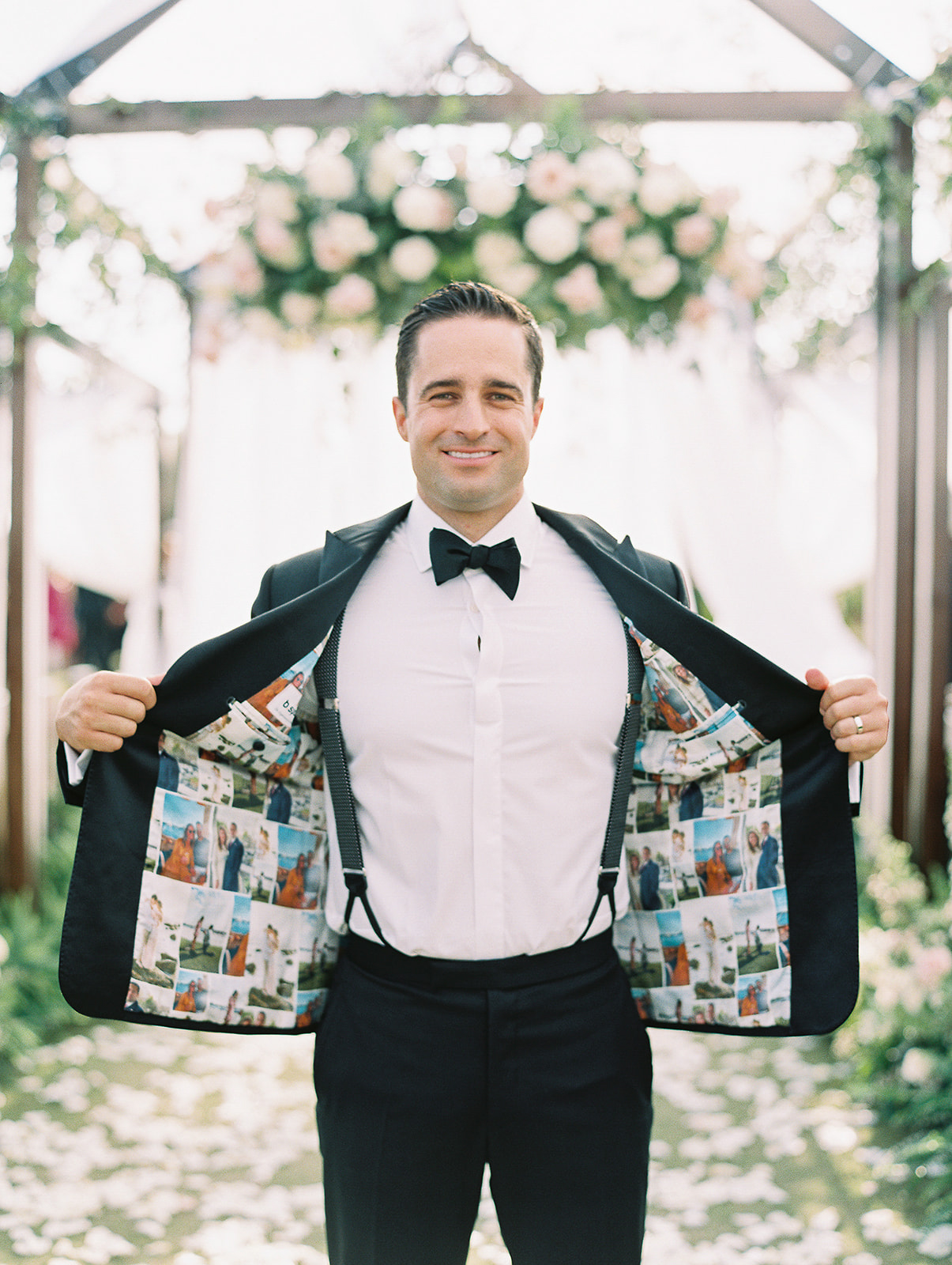 groom holding open suit jacket to show pictures of couple on inside