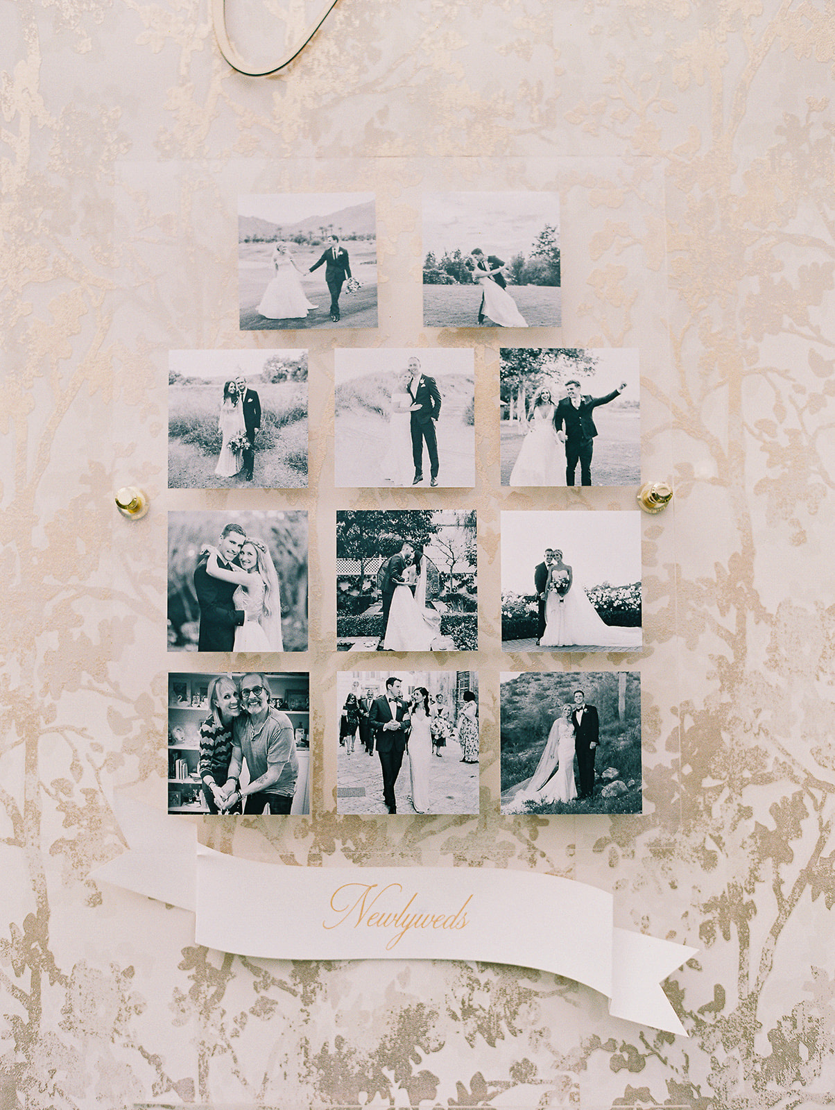 wedding sign with black and white pictures of newlyweds