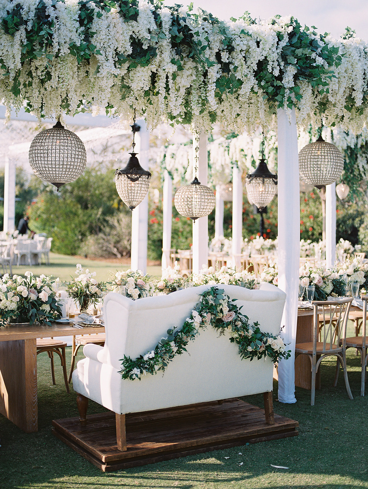 white sweetheart couch at wedding reception