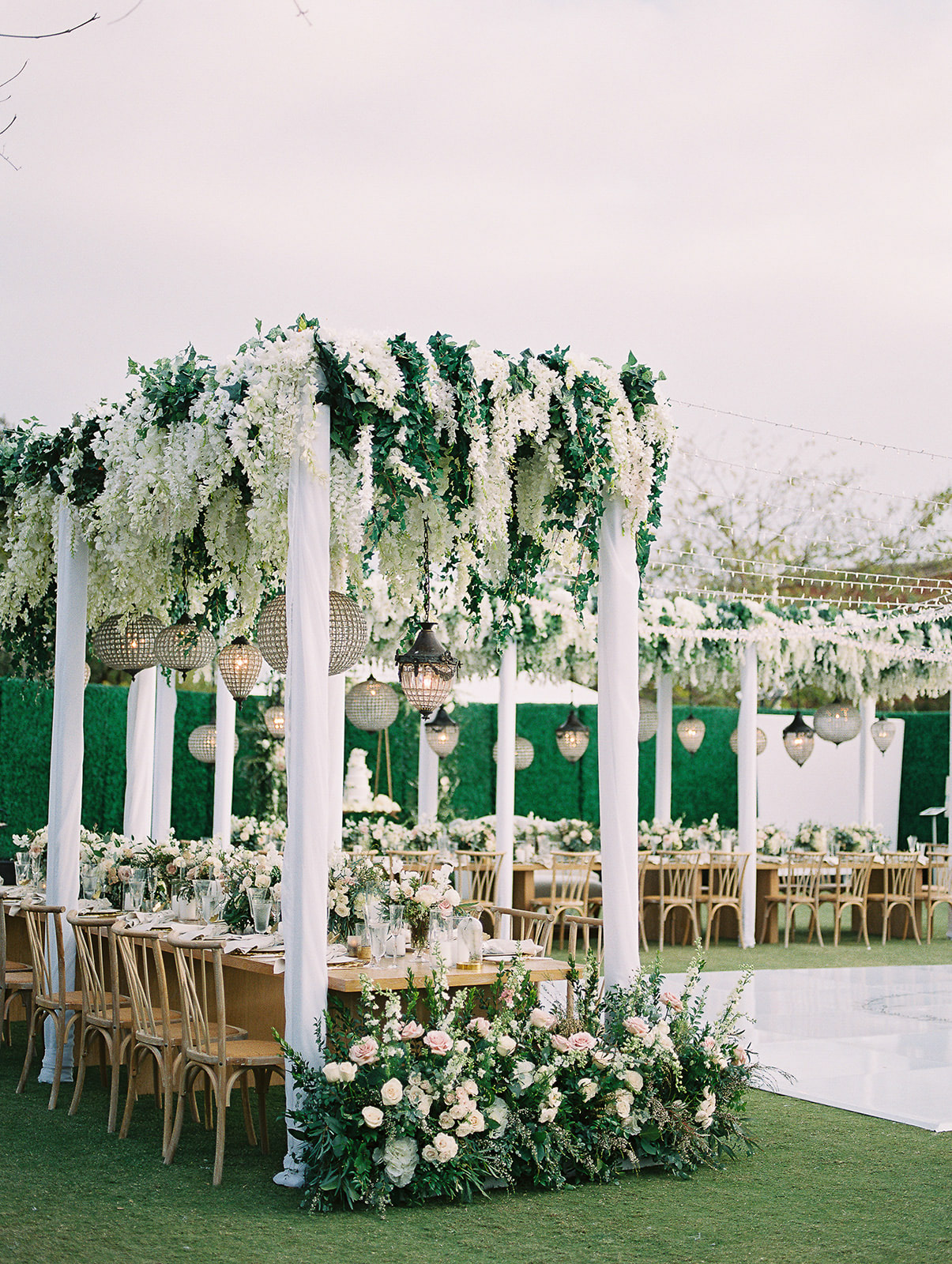 white, pink, and gold outdoor wedding reception tables