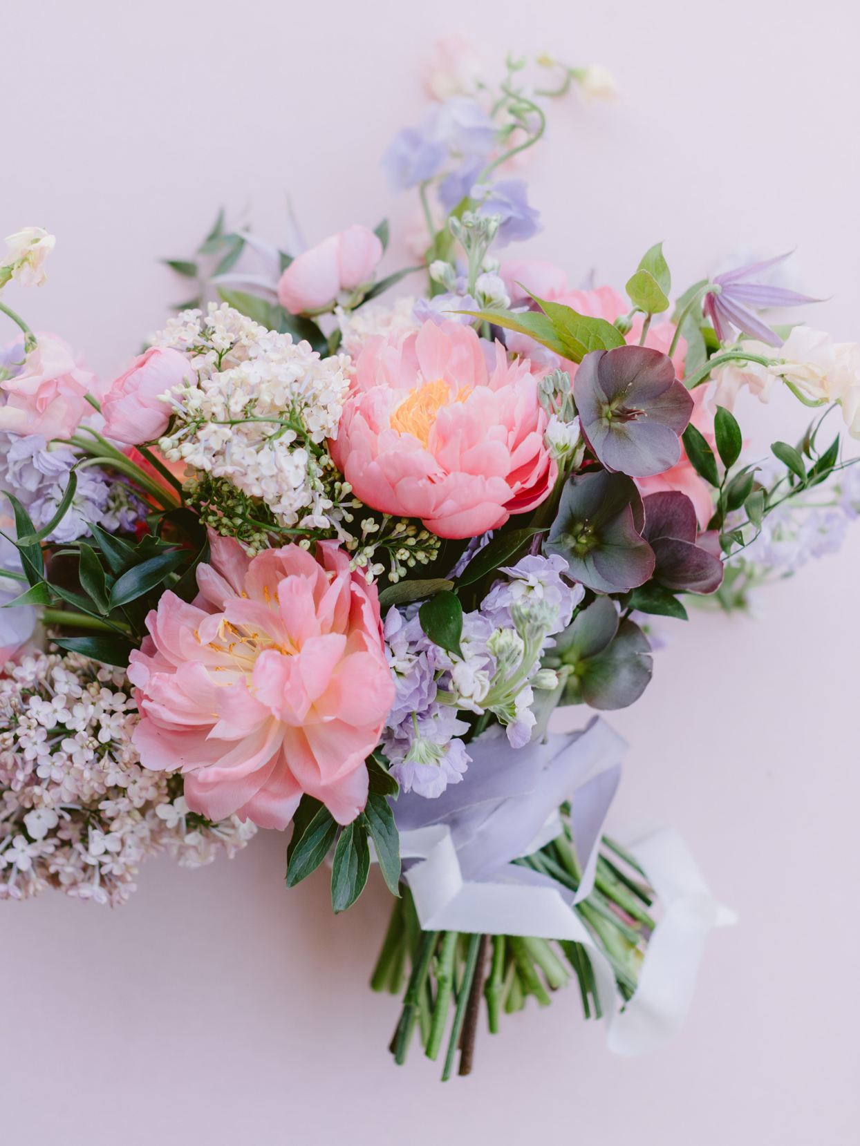 bridal bouquet comprised of peonies lilac and blush sweet peas