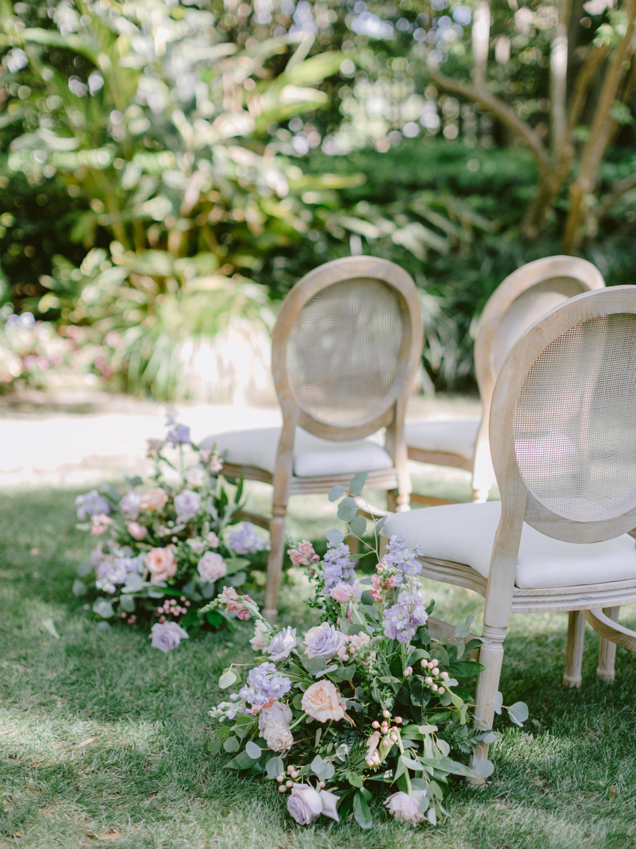wedding ceremony aisle flanked with florals