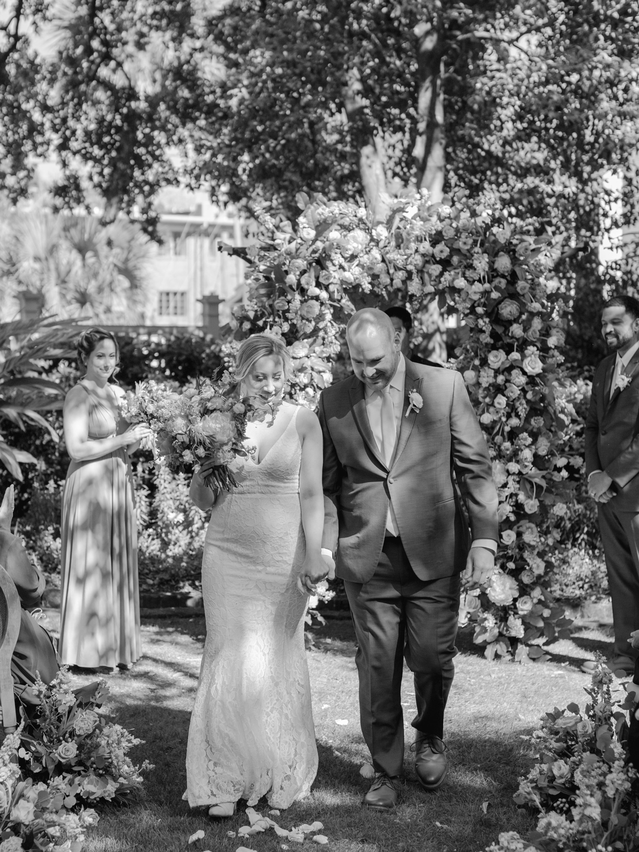 couple holding hands during wedding ceremony recessional